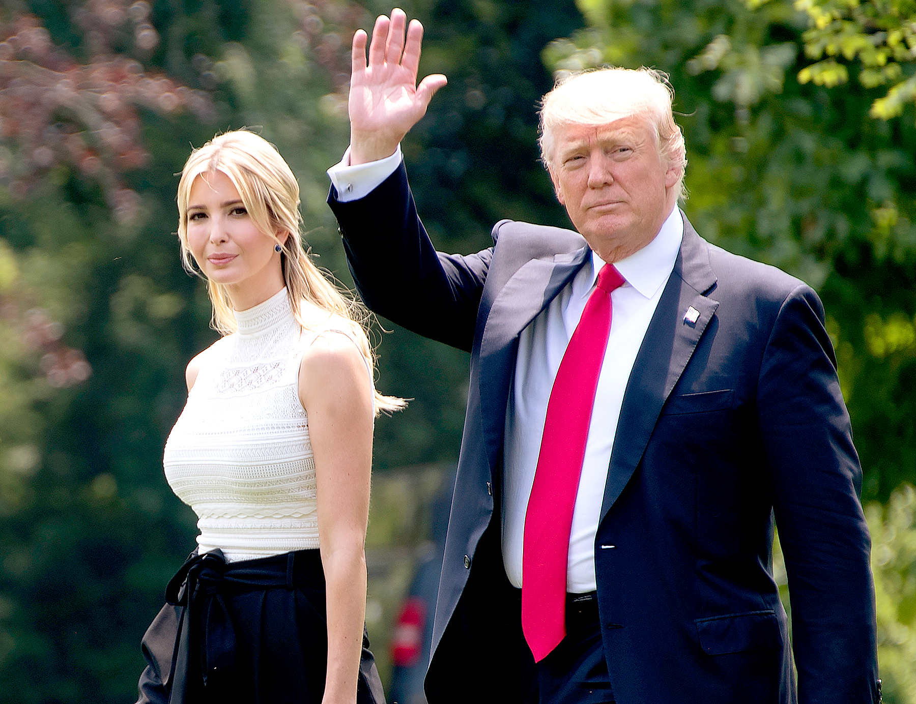 US President Donald Trump walks with his daughter Ivanka as they depart the White House in Washington, DC, June 13, 2017 en route to Wisconsin.