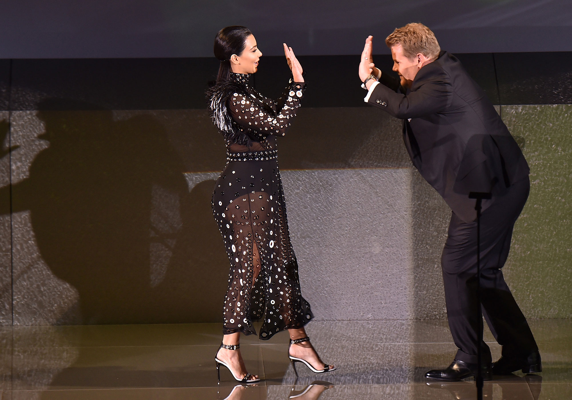 Kim Kardashian and actor James Corden greet onstage at the 2015 CFDA Fashion Awards at Alice Tully Hall at Lincoln Center on June 1, 2015, in New York City