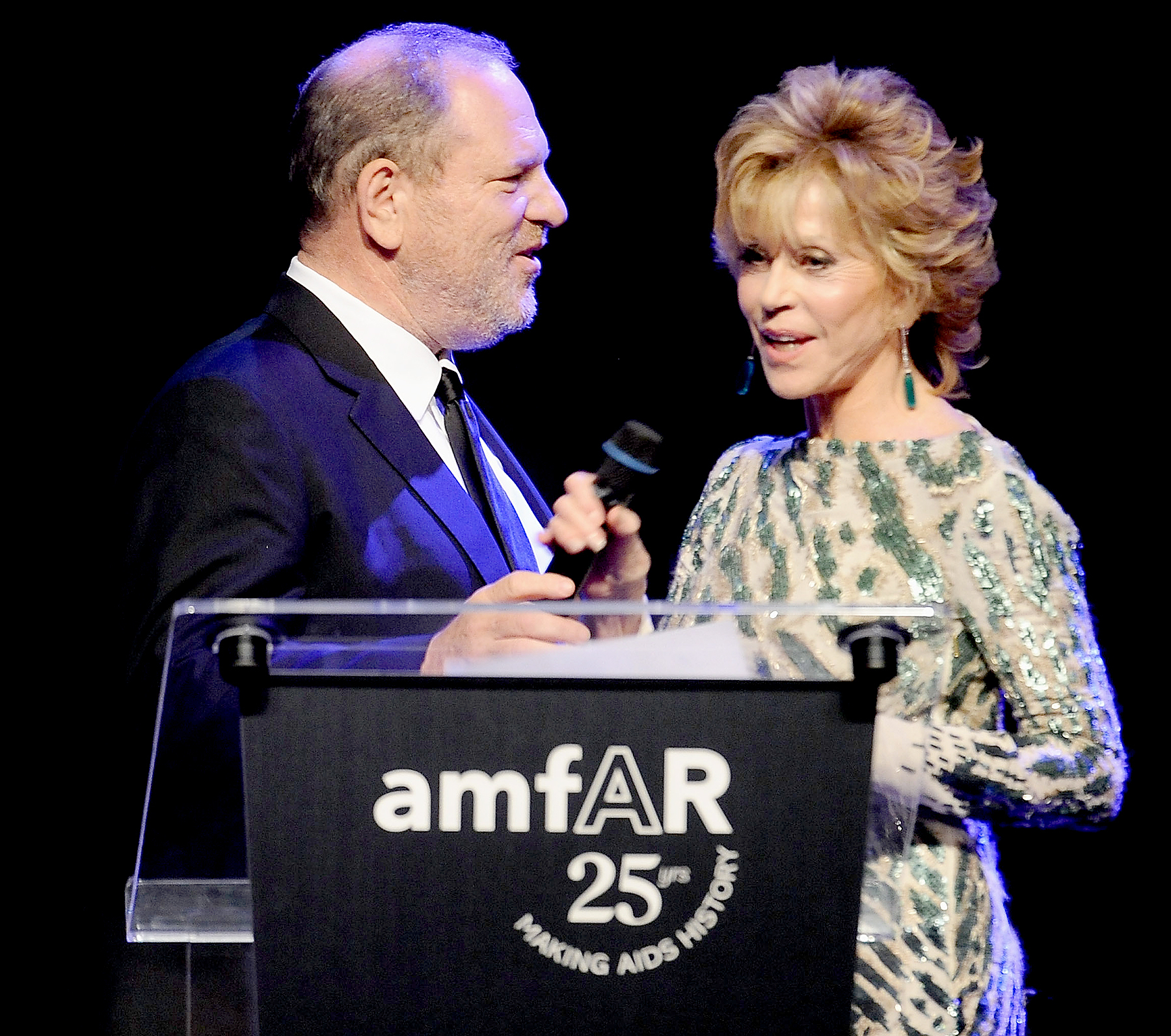Harvey Weinstein and Jane Fonda onstage at amfAR's Cinema Against AIDS Gala during the 64th Annual Cannes Film Festival at Hotel Du Cap on May 19, 2011 in Antibes, France.