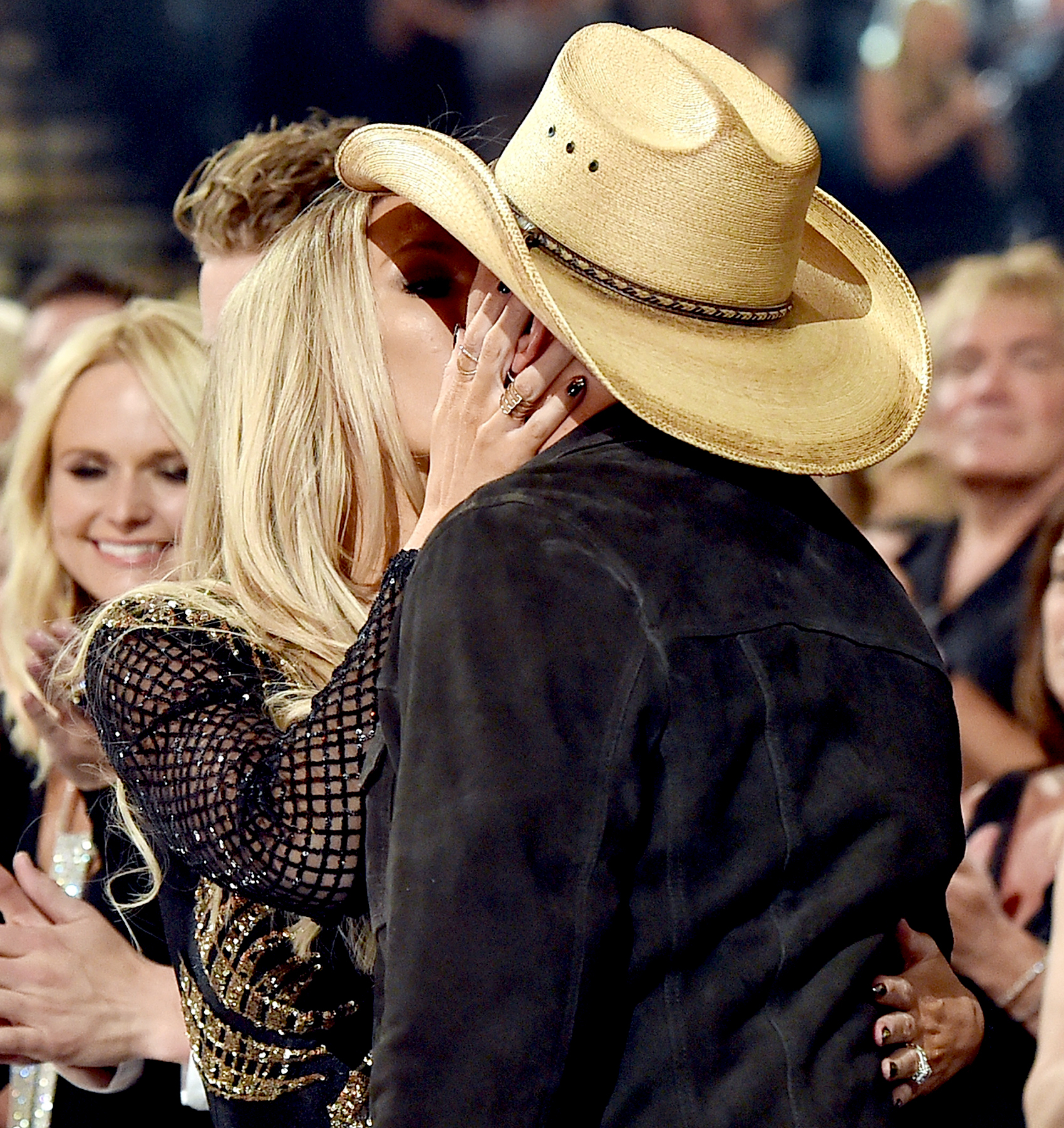 Jason aldean kisses wife brittany kerr after acm awards for Academy of country music award for video of the year