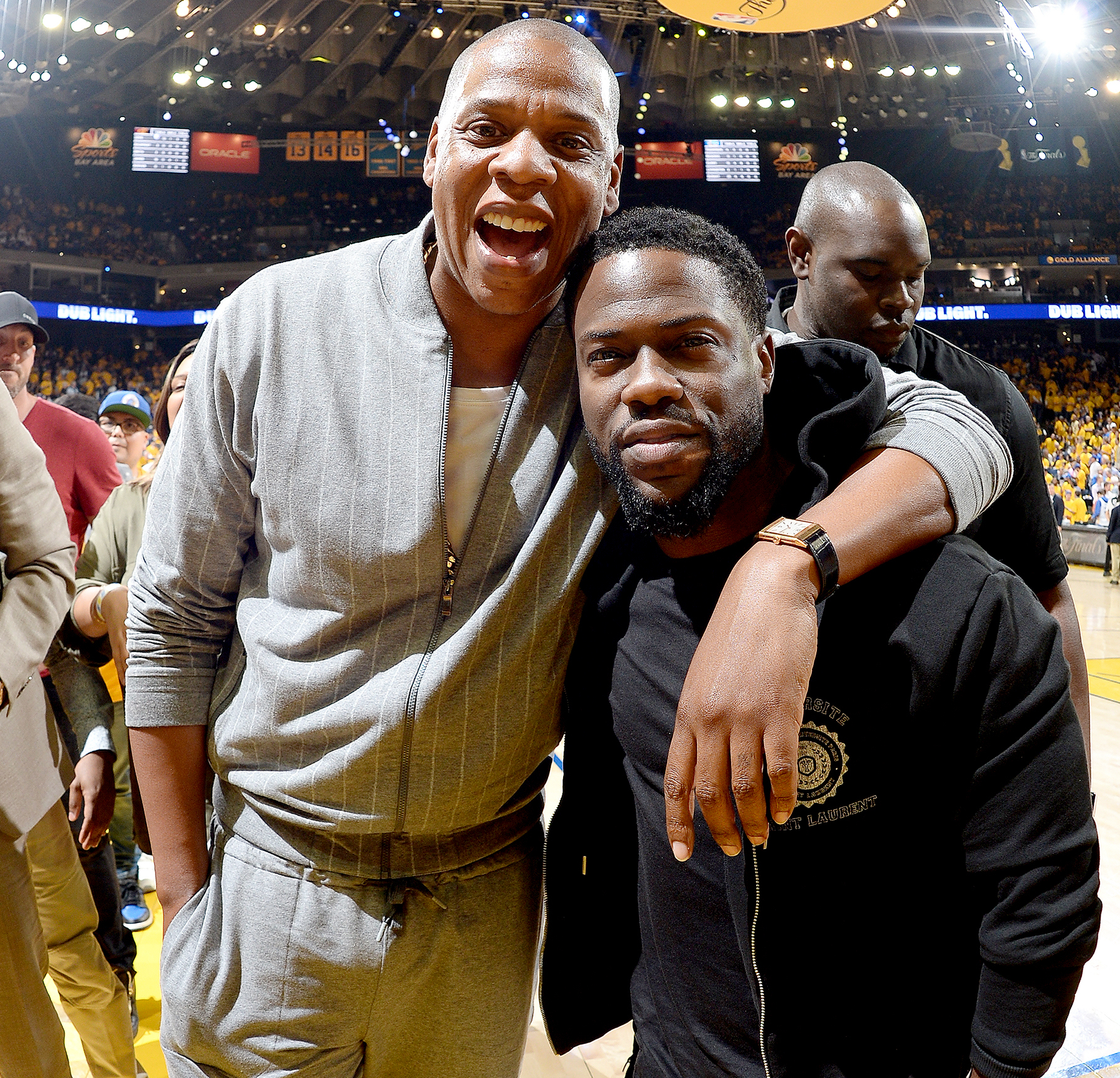Jay-Z and Kevin Hart are seen at the game between the Golden State Warriors and the Cleveland Cavaliers during Game One of the 2017 NBA Finals at Oracle Arena on June 1, 2017 in Oakland, California.