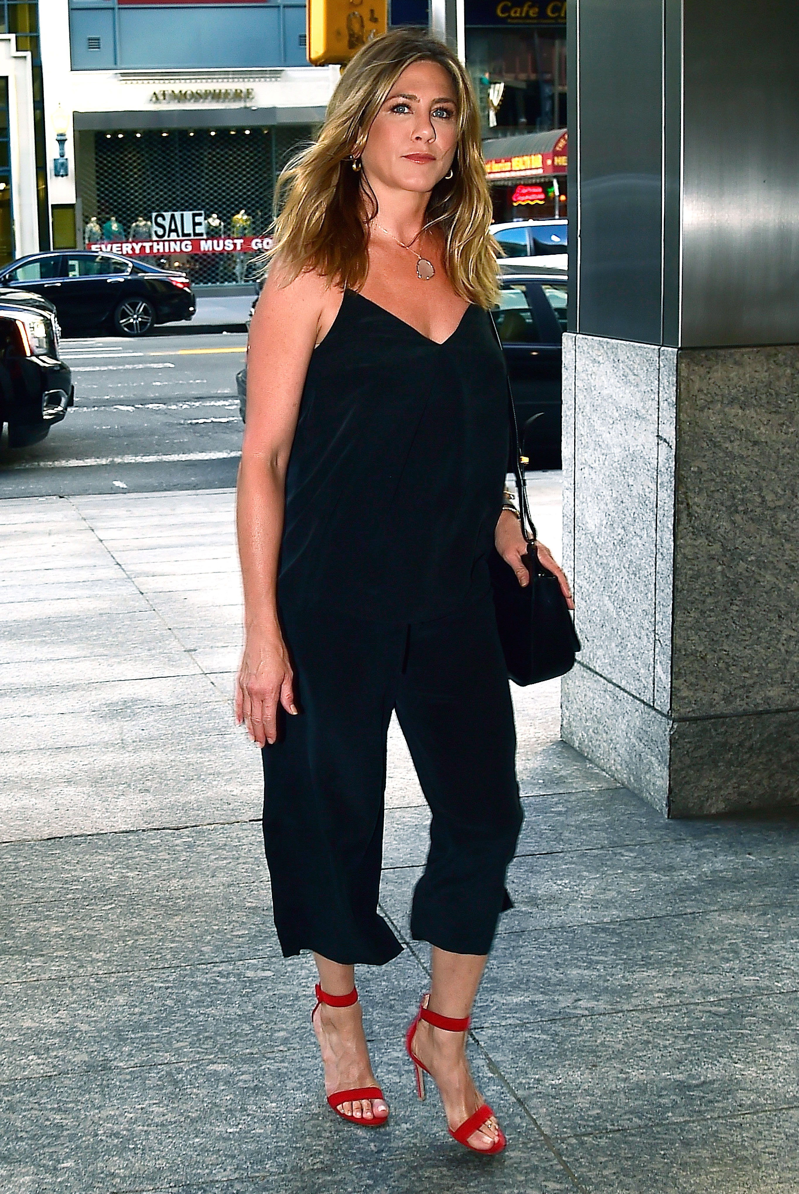 Jennifer Aniston Wears Red Shoes With Her All Black Look