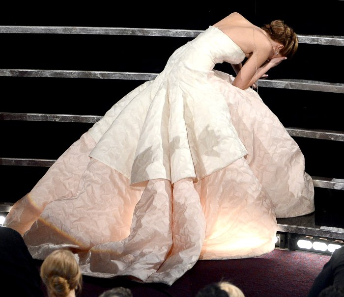 Jennifer Lawrence reacts after winning the Best Actress award for
