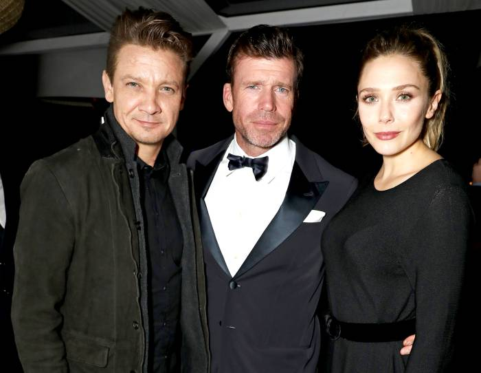 """Jeremy Renner, director Taylor Sheridan and Elizabeth Olsen attend The Weinstein Company party in celebration of """"Wind River"""" in association with de Grisogono, Grey Goose Vodka, Hotel de Crillon, and Lexus at Nikki Beach on May 20, 2017 in Cannes, France."""
