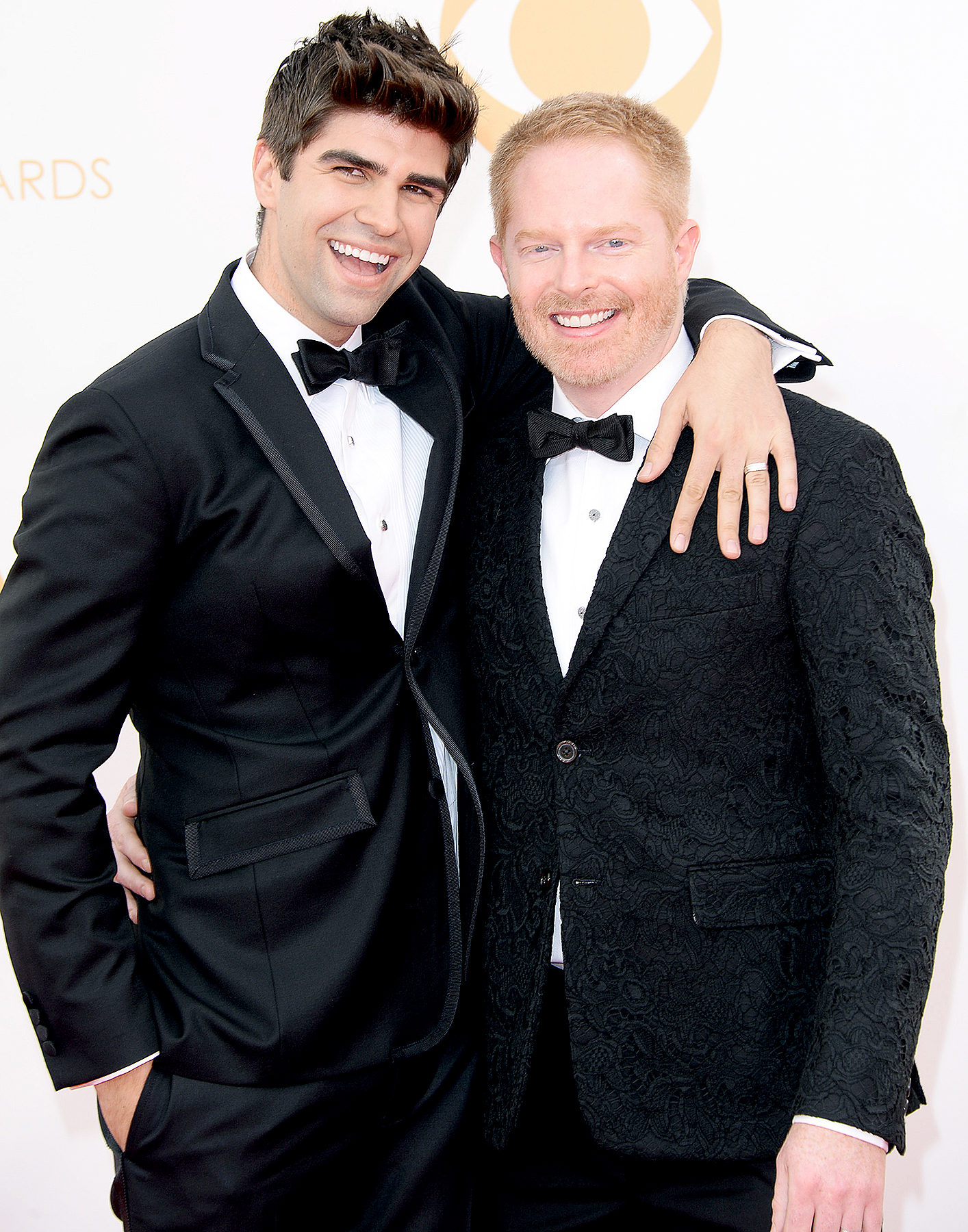 Jesse Tyler Ferguson and Justin Mikita arrive at the 65th Annual Primetime Emmy Awards held at Nokia Theatre L.A. Live on September 22, 2013 in Los Angeles, California.