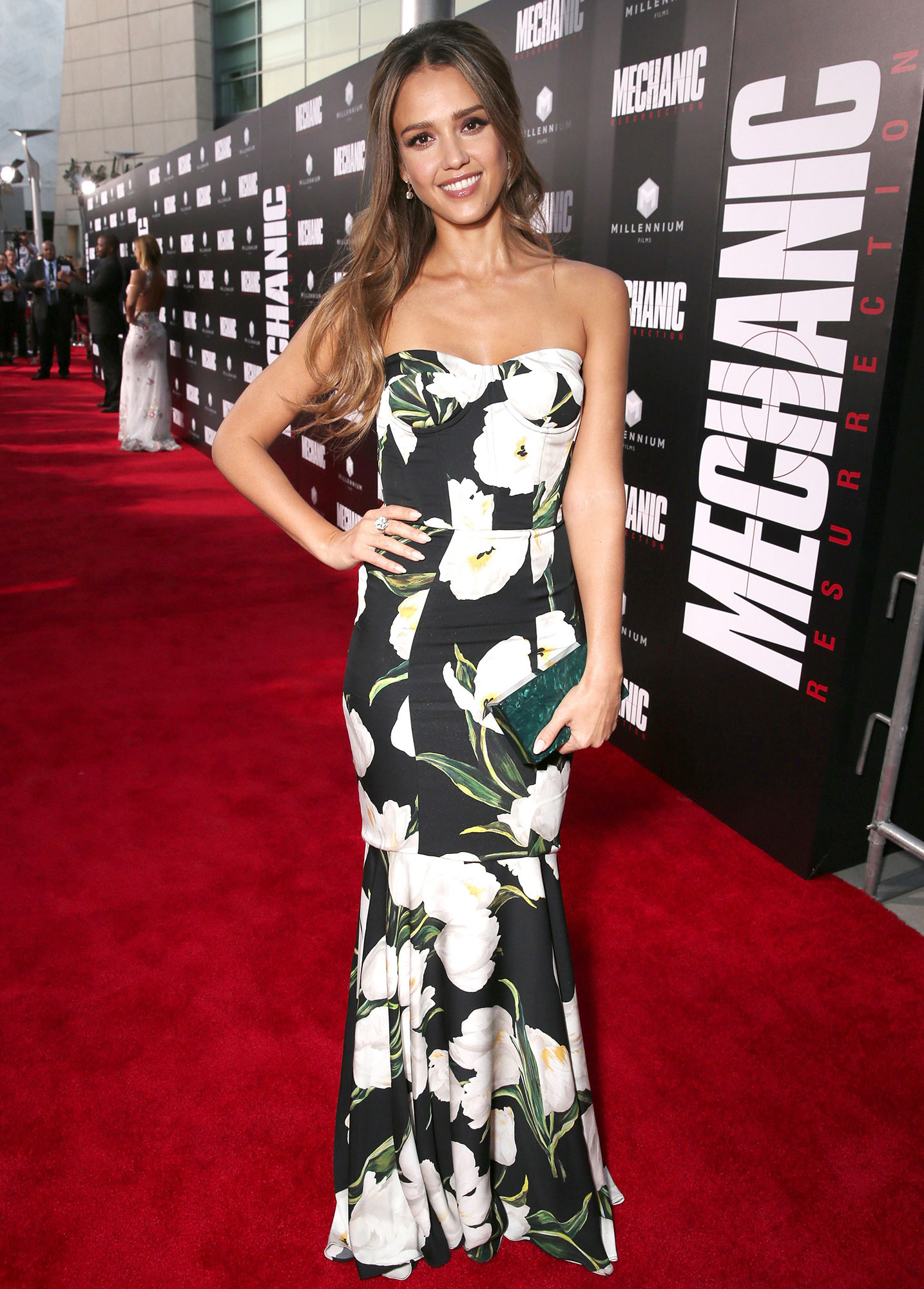a08417ca4e12 Jessica Alba worked the carpet at the premiere of  Mechanic  Resurrection   in a strapless Dolce   Gabbana floral dress. Todd Williamson Getty Images