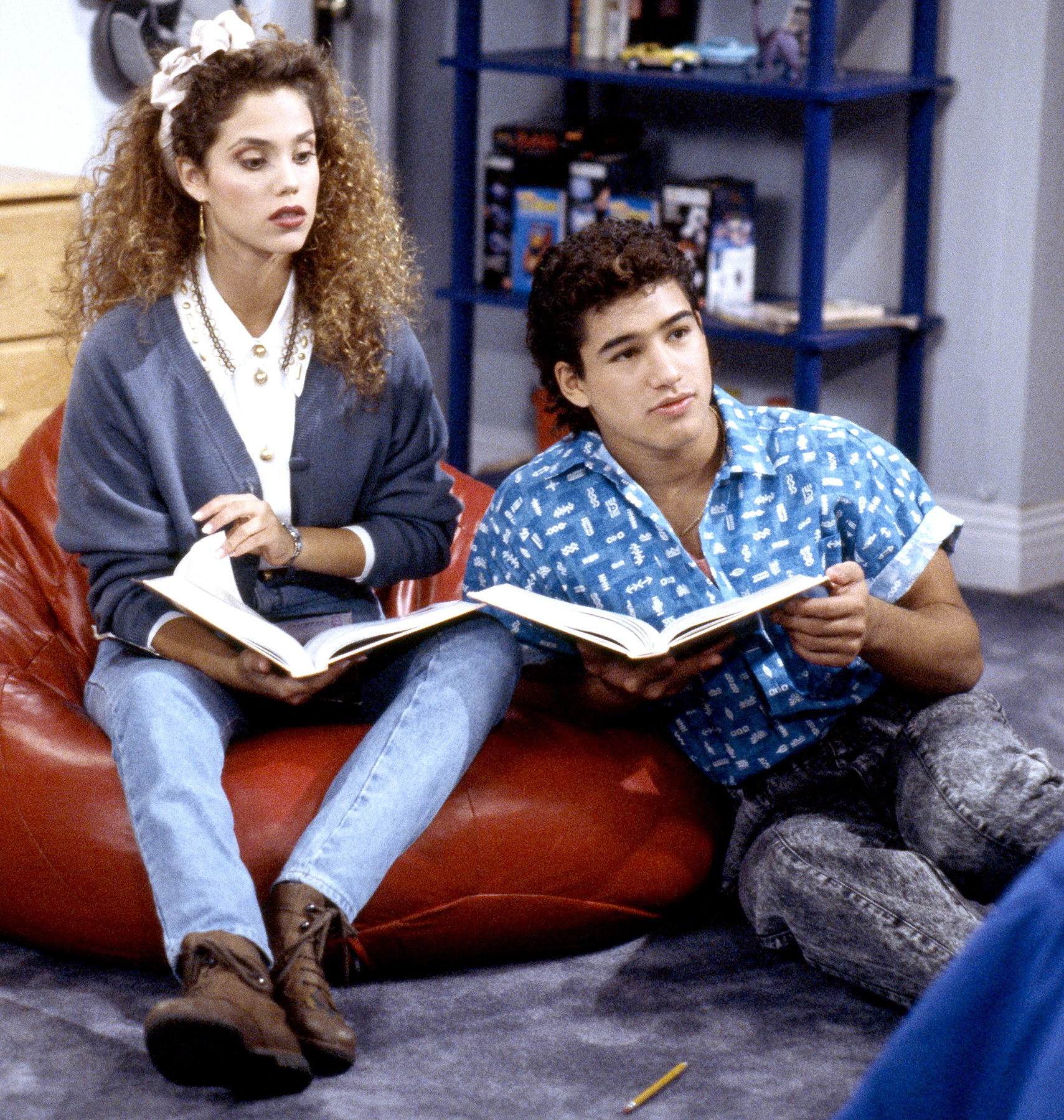 Elizabeth Berkley as Jessie Spano and Mario Lopez as A.C. Slater on Saved by the Bell.