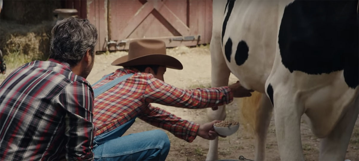 Jimmy Fallon tries to fill up his cereal bowl with some fresh milk as Blake Shelton watches on