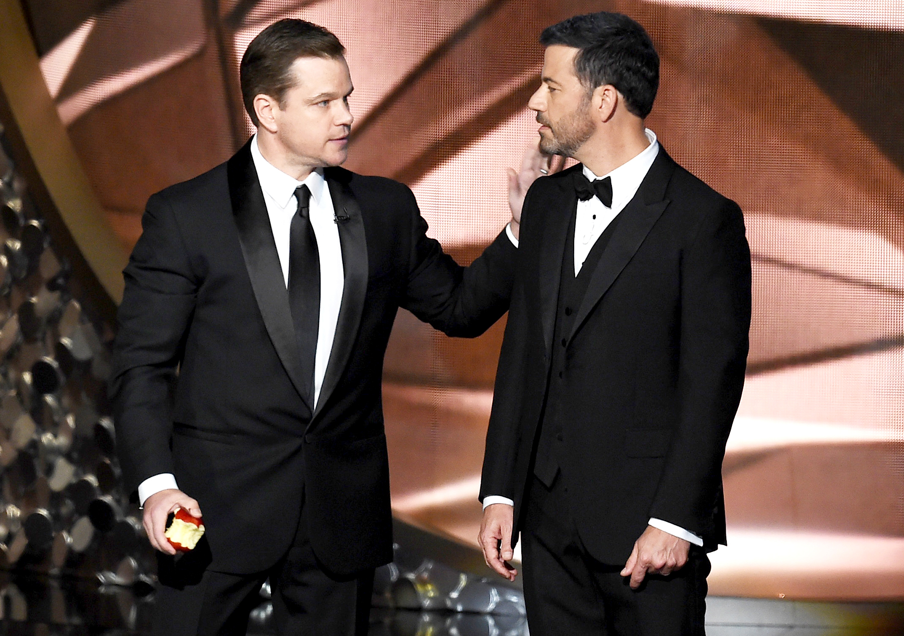 Matt Damon (L) and host Jimmy Kimmel speak onstage during the 68th Annual Primetime Emmy Awards at Microsoft Theater on September 18, 2016 in Los Angeles, California.