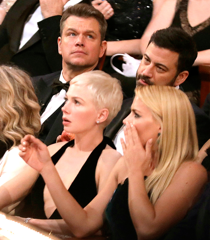 "Audience reacts to ""Moonlight"" being announced as best picture winner at the Oscars on Sunday, Feb. 26, 2017, at the Dolby Theatre in Los Angeles."