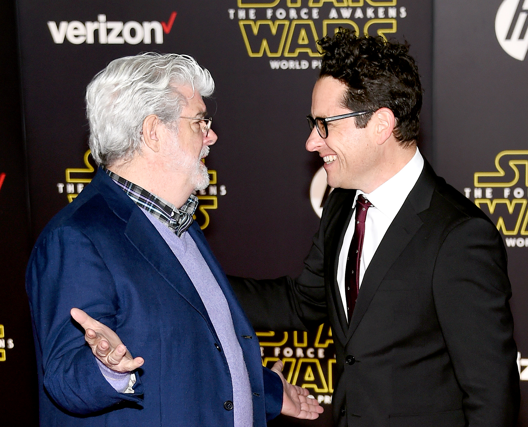 Filmmaker George Lucas and writer-director J.J. Abrams attend the premiere of Walt Disney Pictures and Lucasfilm's Star Wars: The Force Awakens.