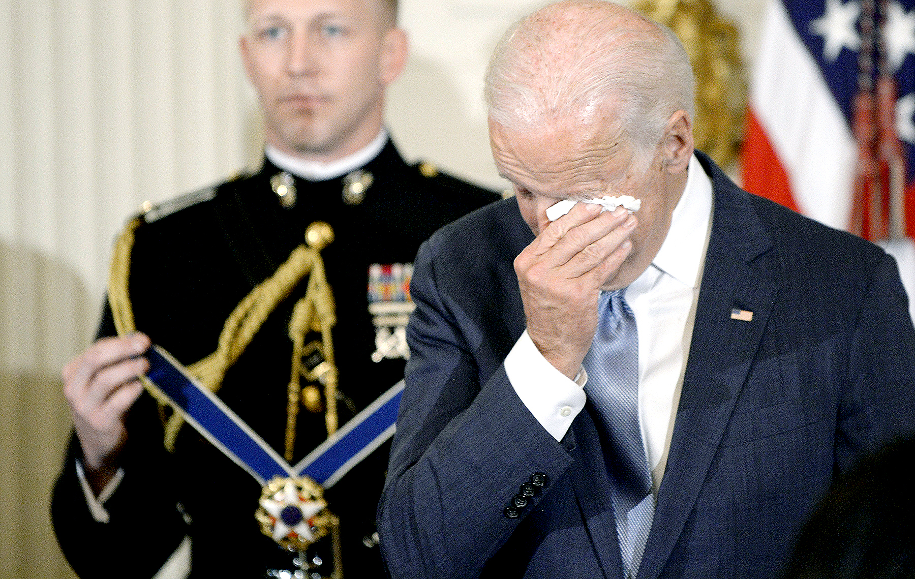 U.S. Vice President Joe Biden wipes his eyes as Preident Barack Obama presents him with Medal of Freedom during an event in the State Dinning room of the White House January 12, 2017 in Washington, DC.