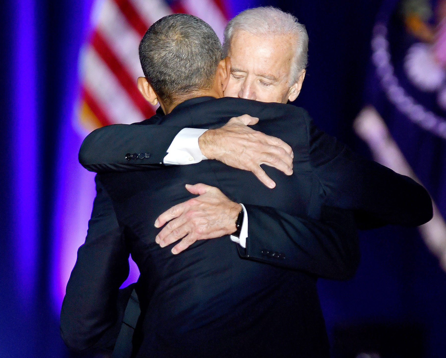U.S. President Barack Obama, front, embraces U.S. Vice President Joe Biden after his farewell address in Chicago, Illinois, U.S., on Tuesday, Jan. 10, 2017.