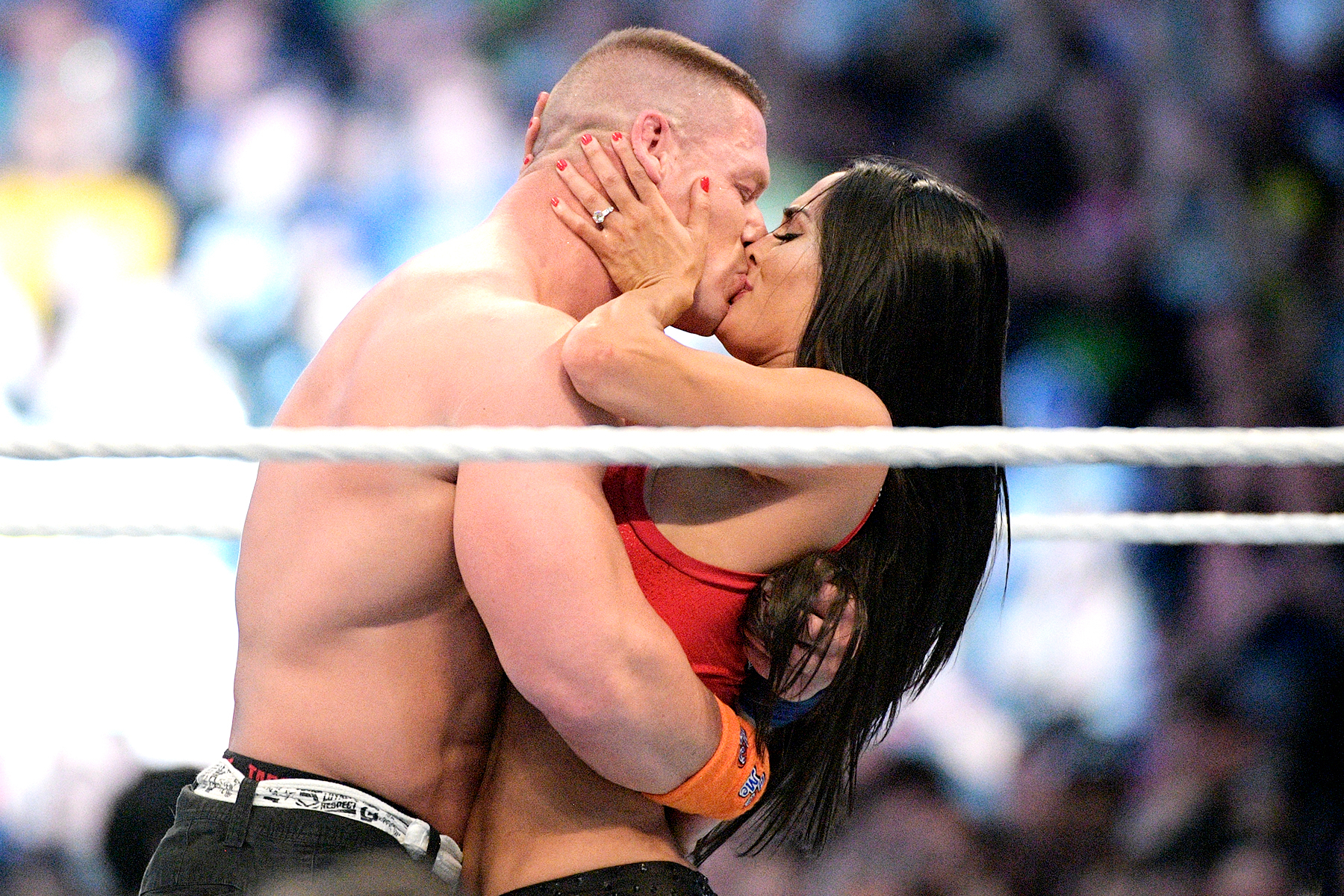 WWE Superstars John Cena, left, and Nikki Bella kiss after she accepted his marriage proposal during WrestleMania 33 on Sunday, April 2, 2017, in Orlando, Fla.