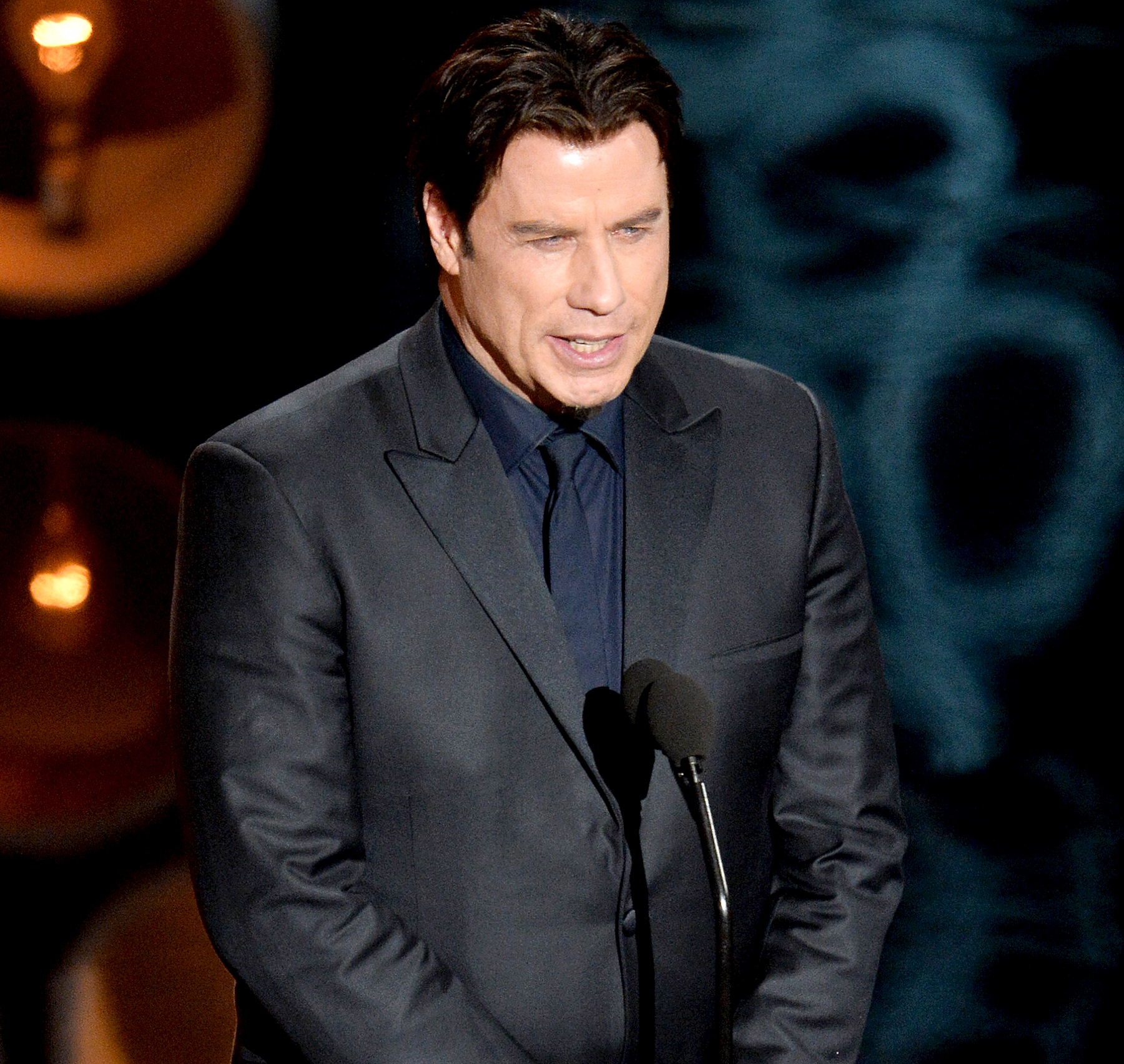 John Travolta speaks onstage during the Oscars at the Dolby Theatre on March 2, 2014 in Hollywood, California.