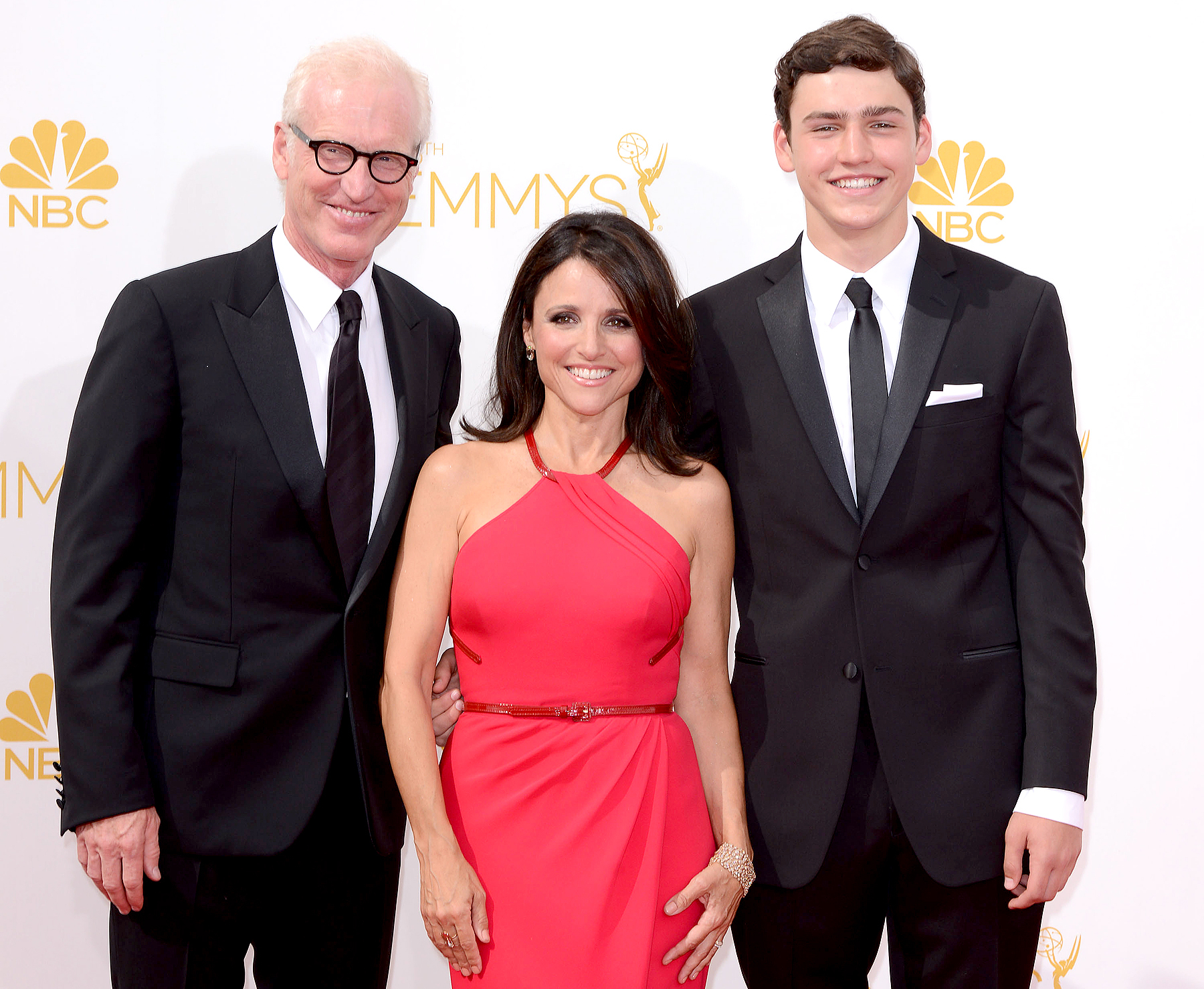 Julia Louis-Dreyfus (C), Brad Hall (L), and Charles Hall (R) arrive to the 66th Annual Primetime Emmy Awards at Nokia Theatre L.A. Live on August 25, 2014 in Los Angeles, California.