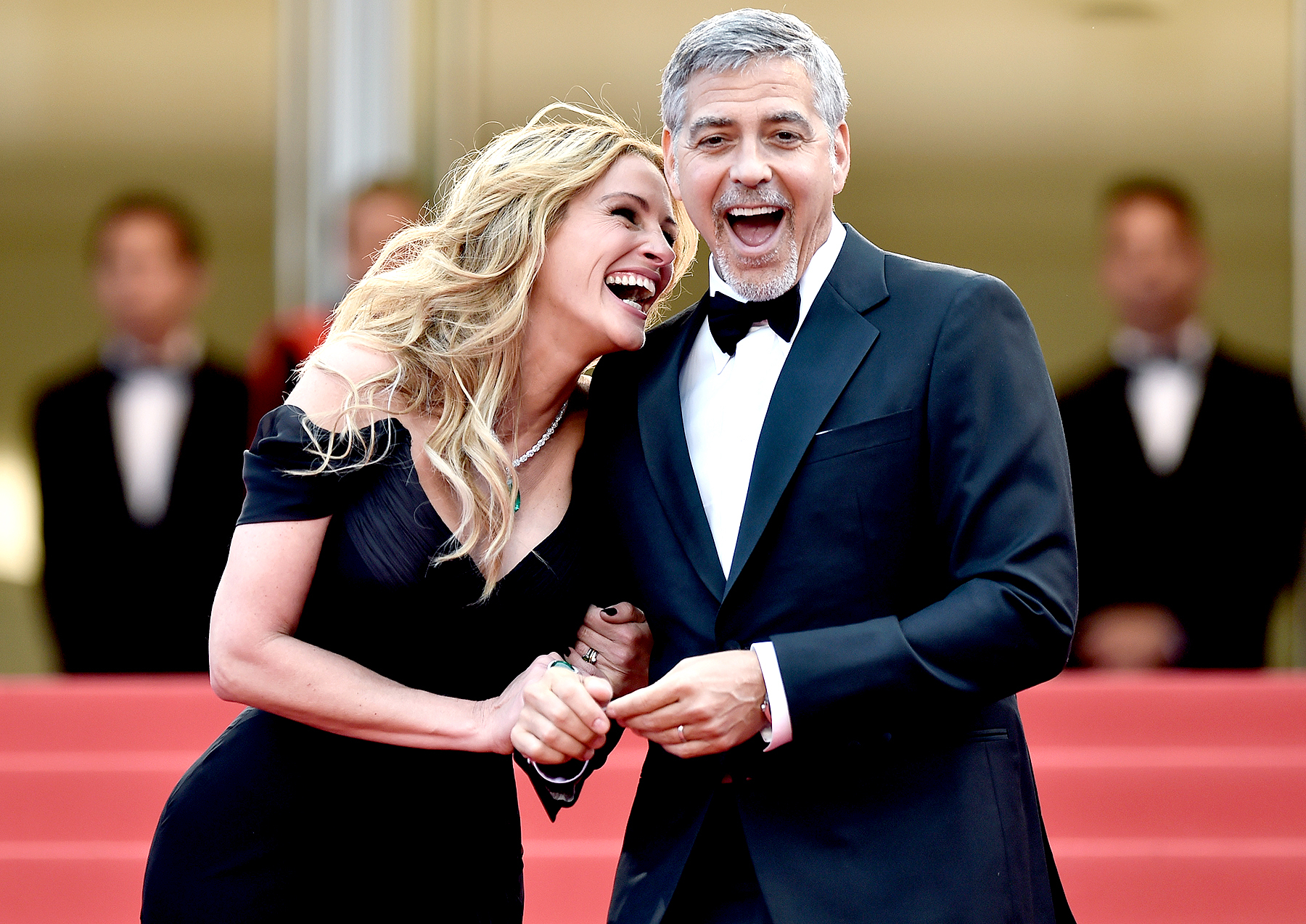 "Julia Roberts and George Clooney attend the ""Money Monster"" premiere during the 69th annual Cannes Film Festival at the Palais des Festivals on May 12, 2016 in Cannes, France."