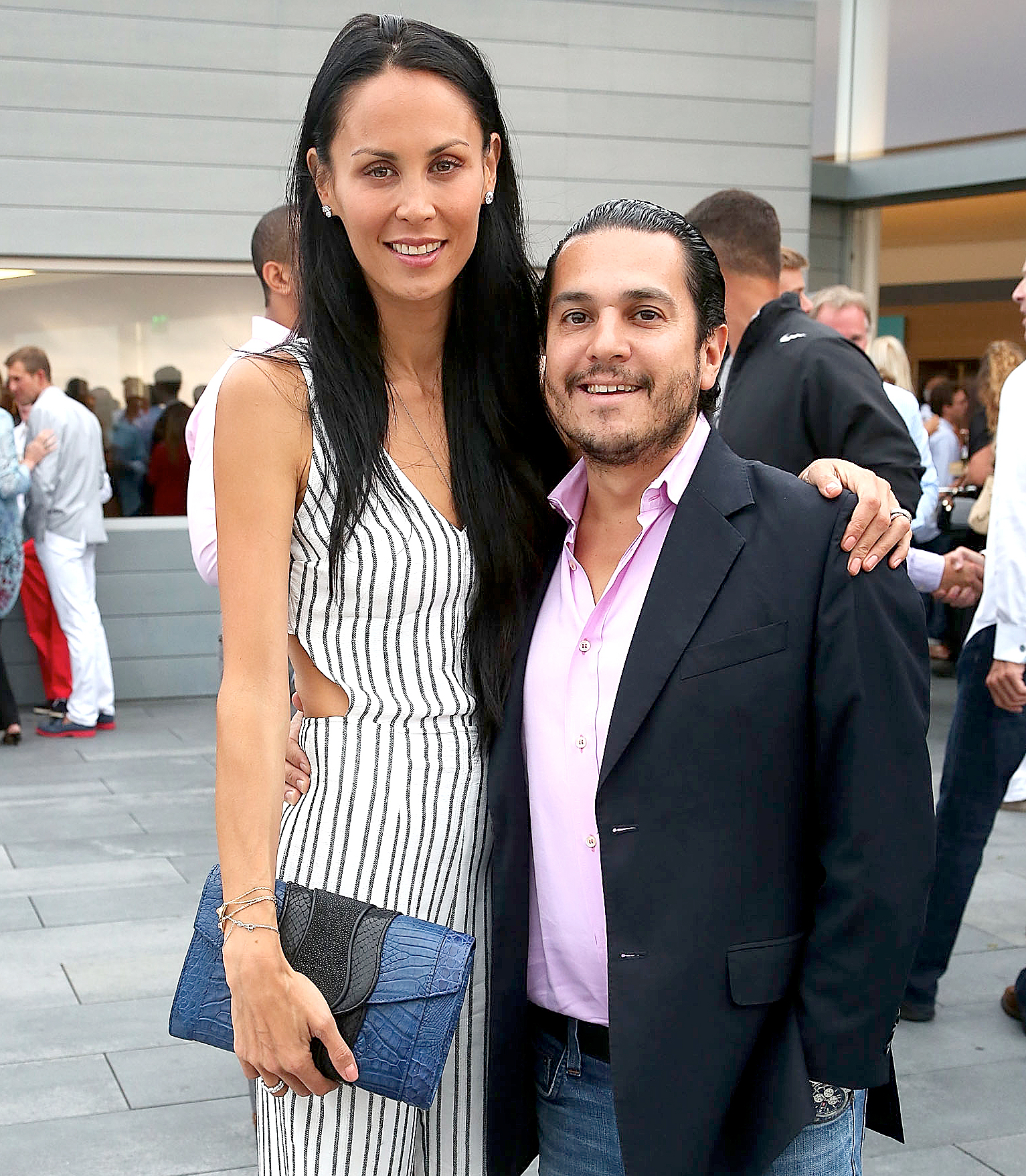 Julianne and Michael Wainstein attend the USTA Serves 2nd annual Pro-Am reception , sponsored by Sothebys, and BMW at The Bridge Golf Club on August 22, 2013 in Sag Harbor, New York.