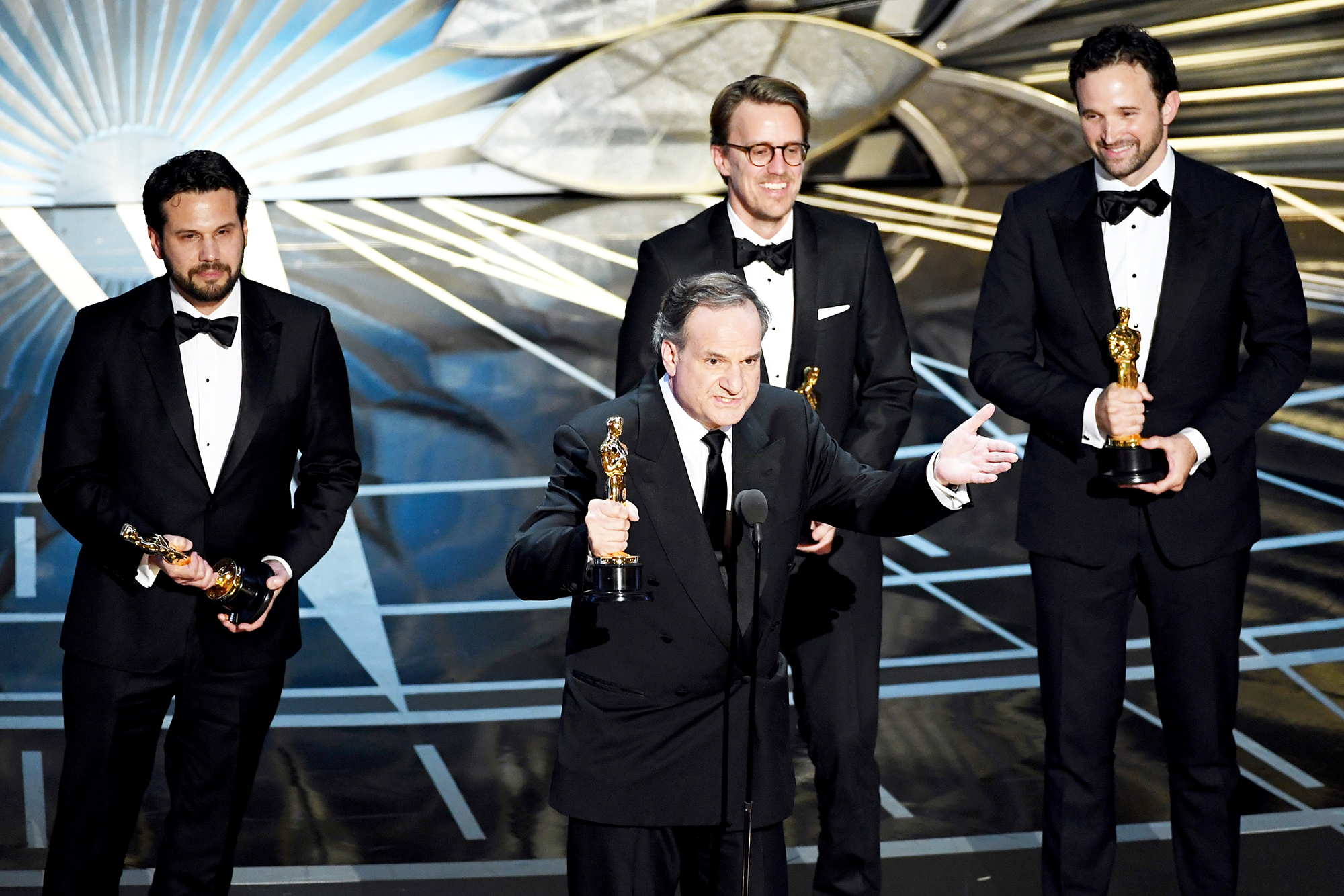 Robert Legato (at microphone) and (L-R) Adam Valdez, Andrew R. Jones, and Dan Lemmon accept Best Visual Effects for 'The Jungle Book' onstage during the 89th Annual Academy Awards at Hollywood & Highland Center on February 26, 2017 in Hollywood, California.
