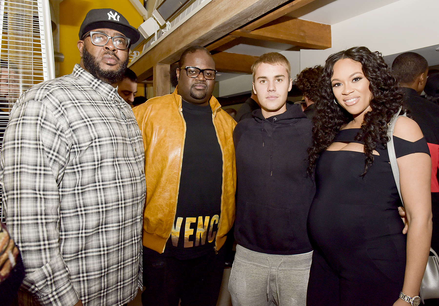 Songwriter Poo Bear, Justin Bieber, and Ashley Boyd pose for portrait at the Poo Bear GRAMMY Party at Serafina Sunset on February 11, 2017 in West Hollywood, California.