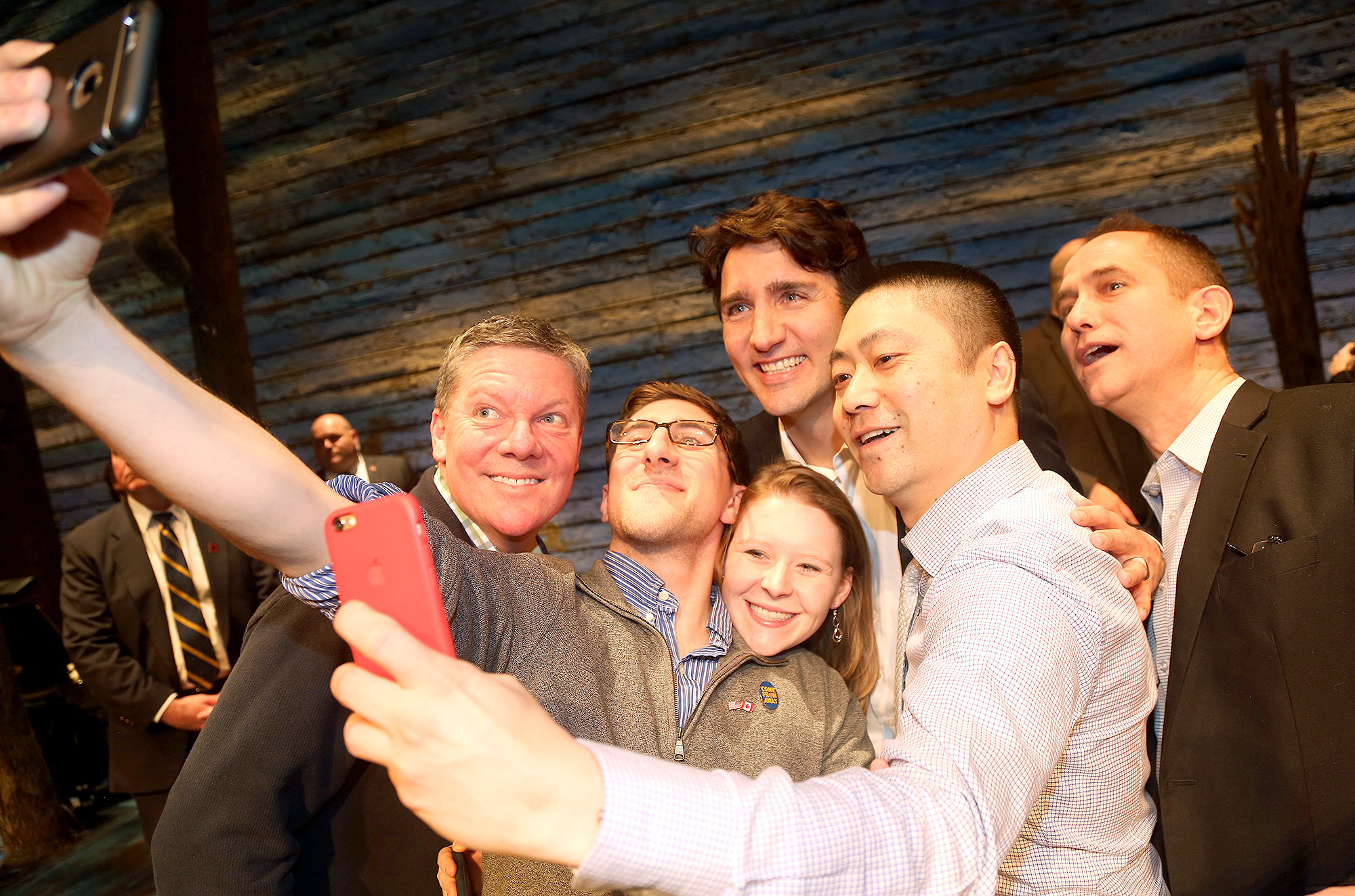 "Canadian Prime Minister Justin Trudeau poses for a selfie with the crew backstage at the hit musical ""Come from Away"" on Broadway at The Schoenfeld Theatre on March 15, 2017 in New York City"