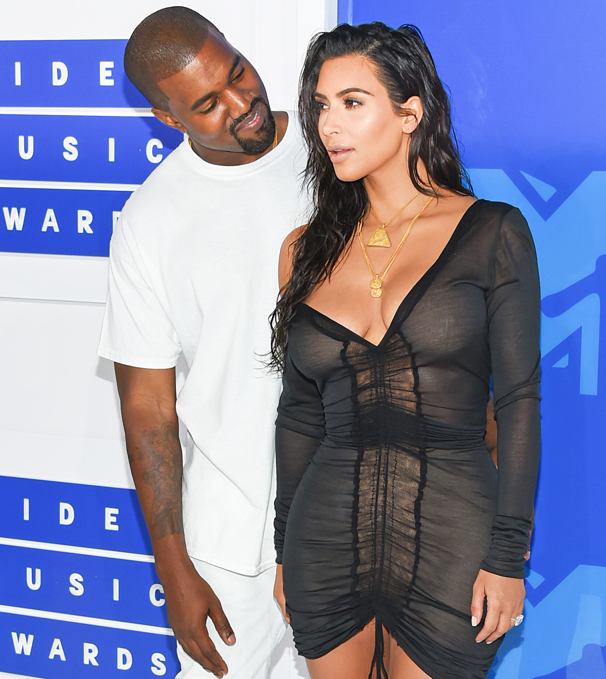Kanye West Kim Kardashian stay with him together breakup break up rumors