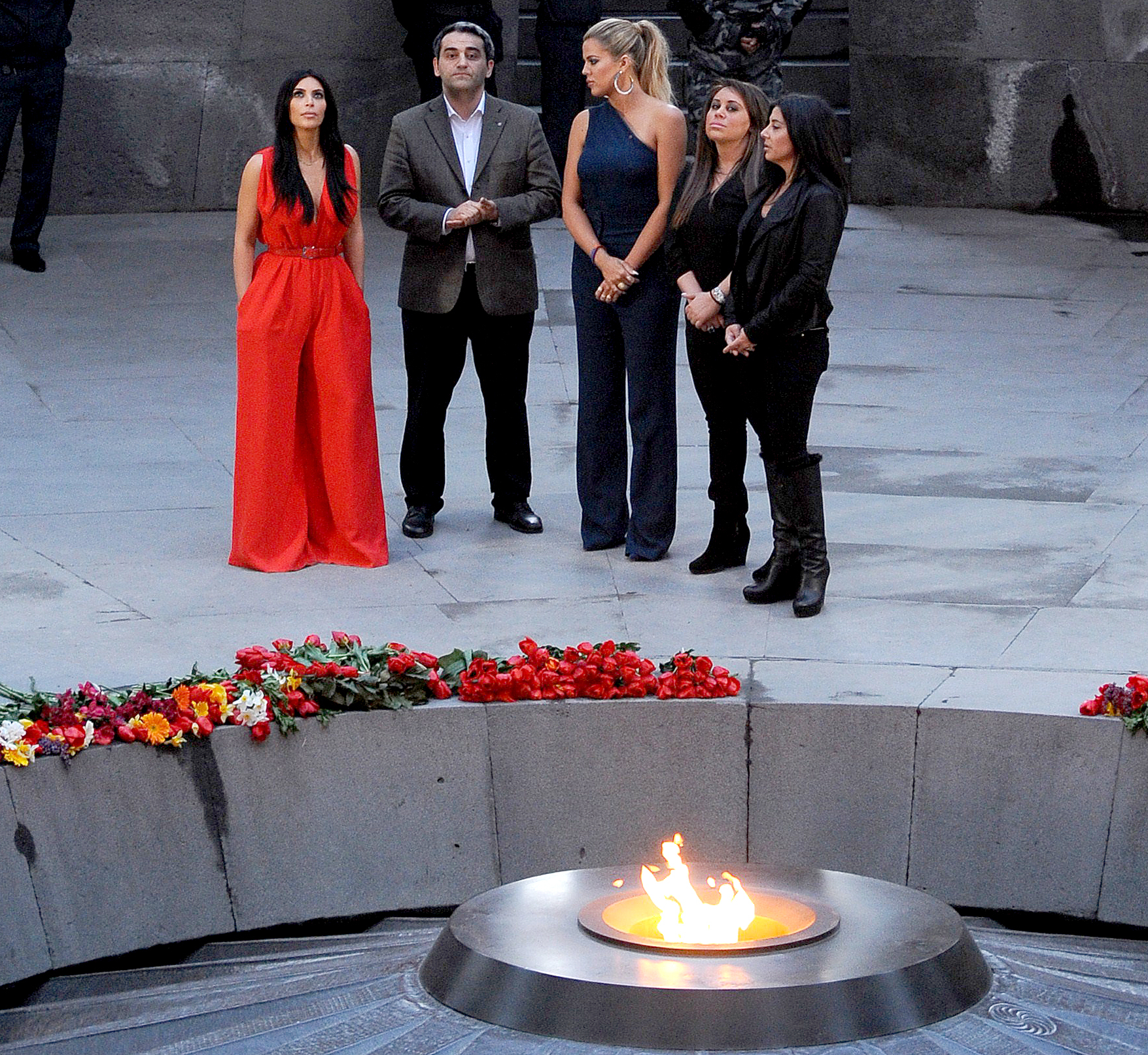 Kim Kardashian and her sister Khloe visit the genocide memorial, which commemorates the 1915 mass killing of Armenians in the Ottoman Empire, in Yerevan on April 10, 2015.