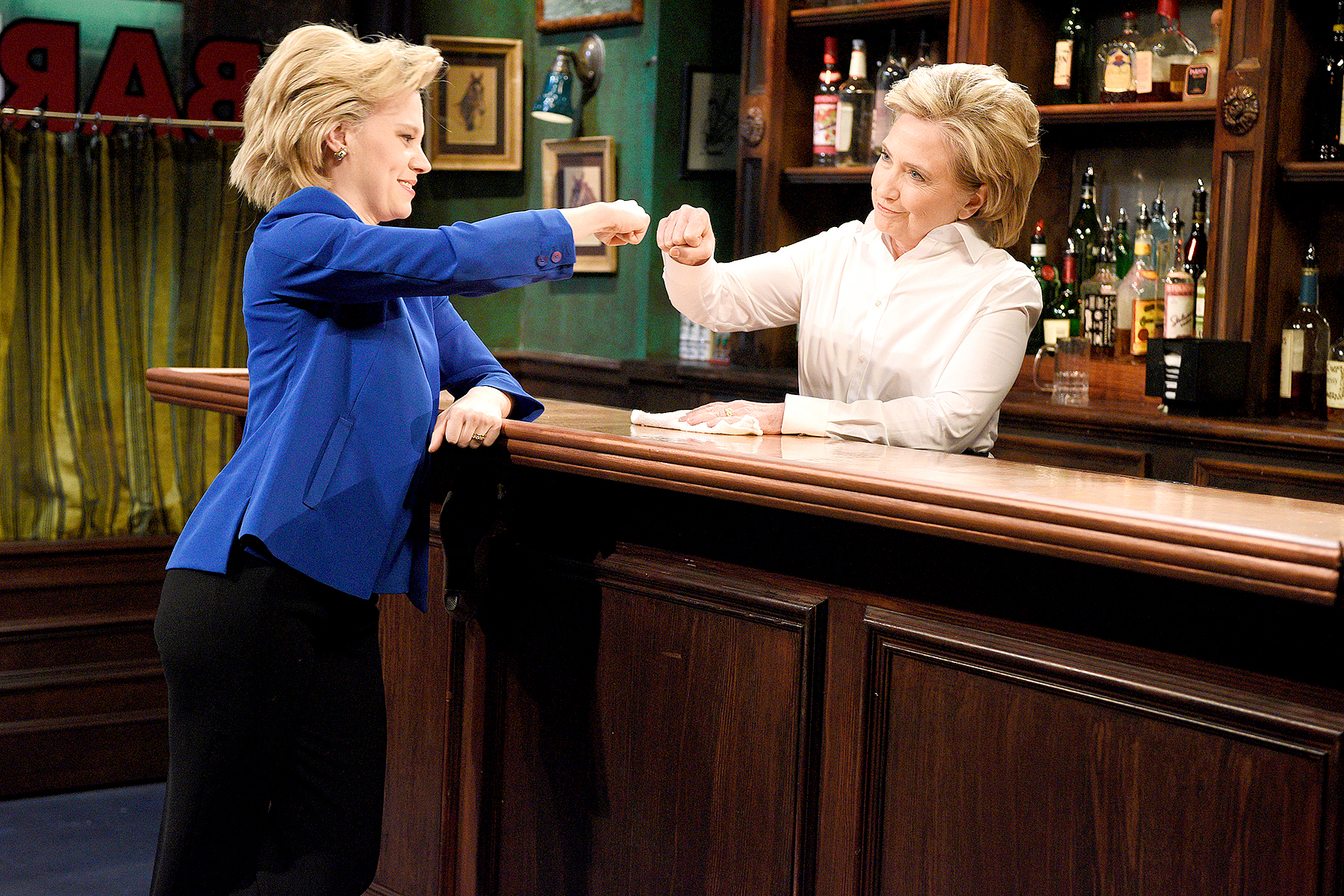 "Kate McKinnon as Hillary Clinton and Hillary Clinton as Val during the ""Bar Talk"" sketch on October 3, 2015 on Saturday Night Live."
