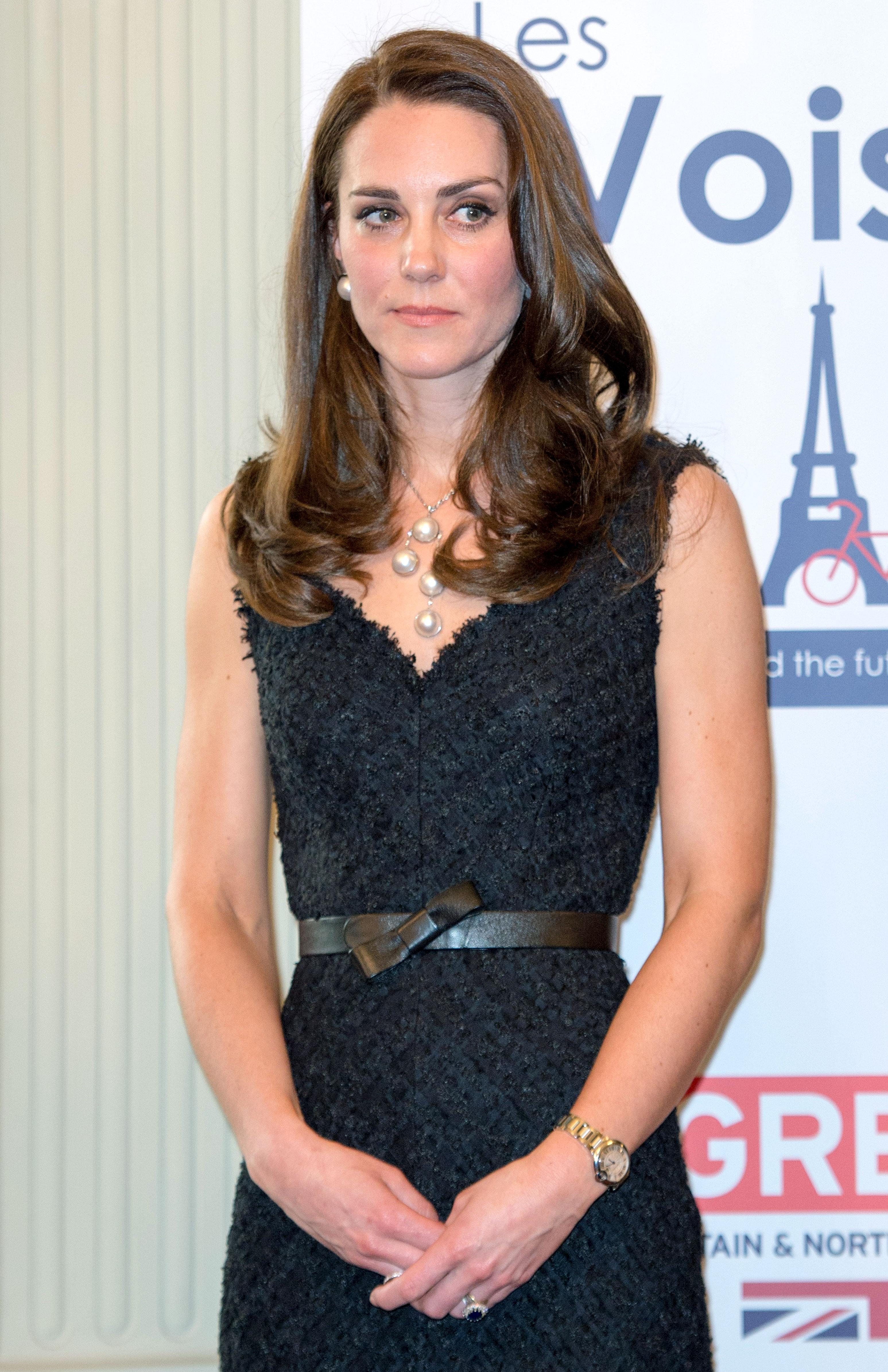 b7dc04a8a3b Duchess Kate works Parisian-chic in a textured dress. Stephane  Cardinale Corbis Getty ...