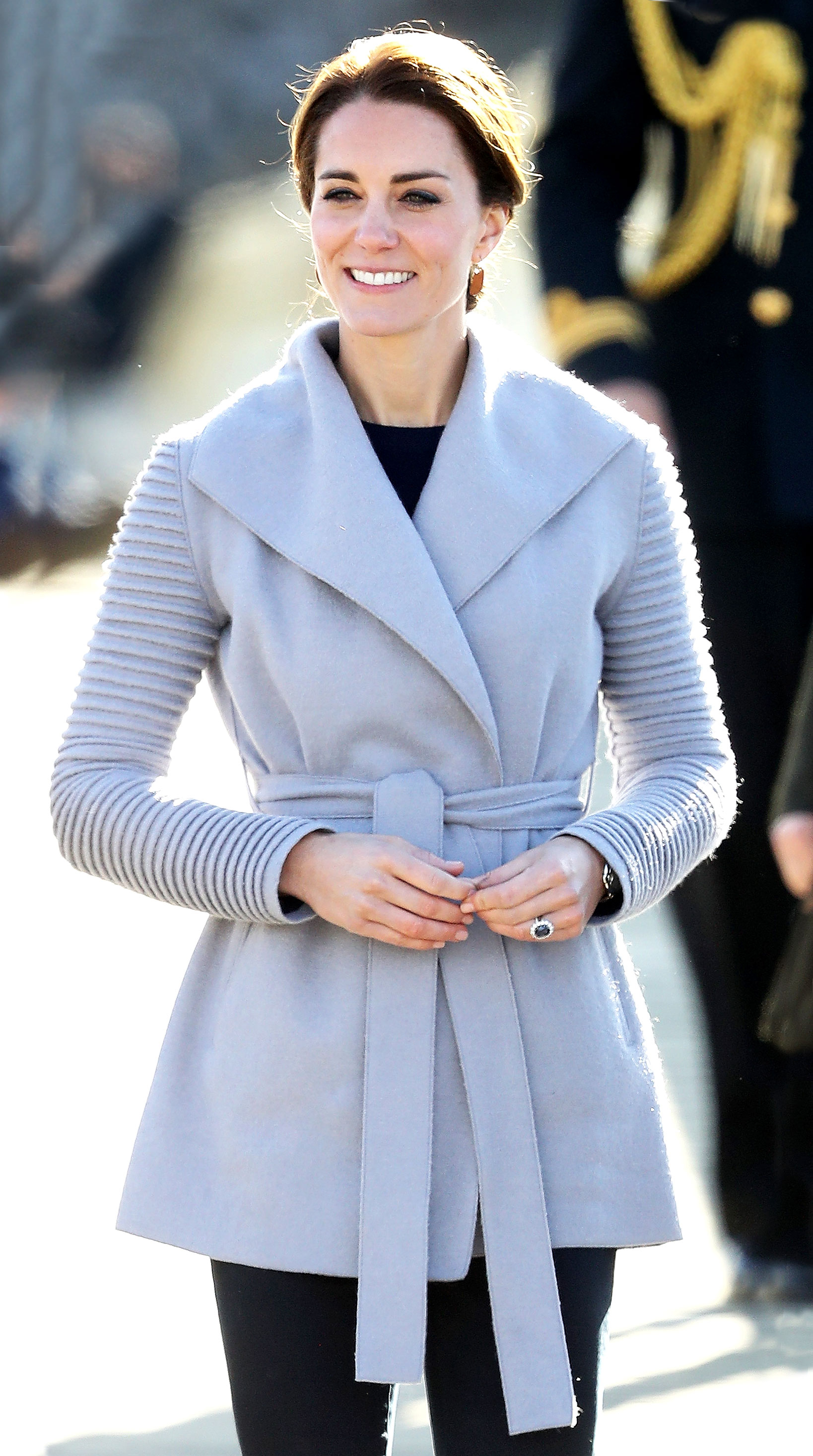 e1baf8d82e0 Duchess Kate wore a gray coat with ribbed sleeves during her royal tour of  Canada