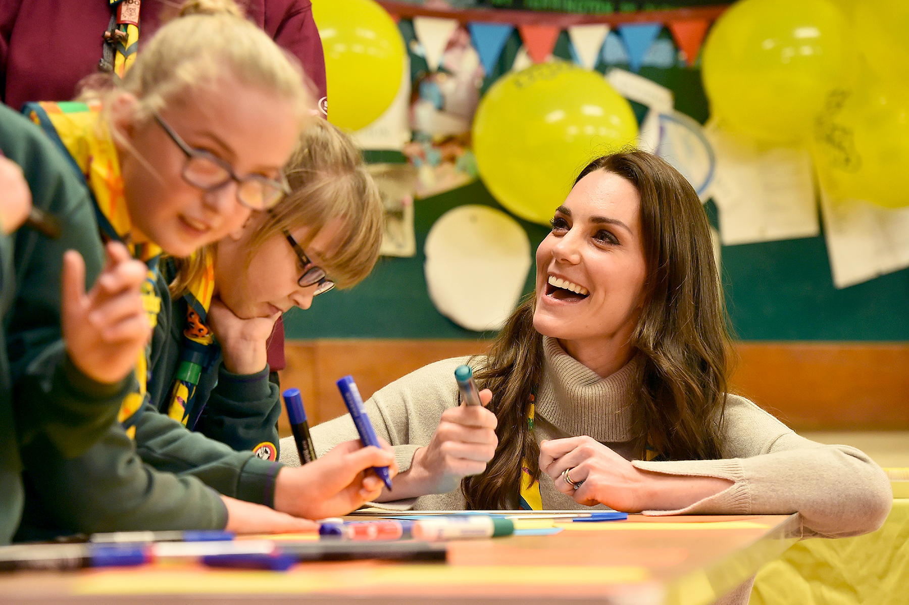 Britain's Catherine, Duchess of Cambridge, reacts as she talks with cubs during a Cub Scout Pack meeting with cubs from the Kings Lynn District, in Kings Lynn, eastern England, on December 14, 2016, to celebrate 100 years of Cubs. The Duchess attended a special Cub Scout Pack meeting with Cubs from the Kings Lynn District to celebrate 100 years of Cubs. Cub Scouting was co-founded by Robert Baden-Powell and Vera Barclay on the 16th December 1916.