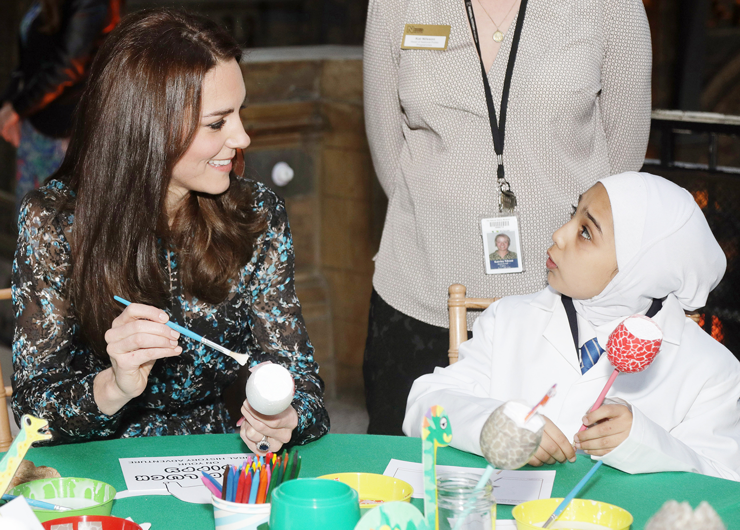 Catherine, Duchess of Cambridge, makes a dinosaur egg with pupils from Oakington Manor Primary School, at the Natural History Museum in London on November 22, 2016, as she atttends a children's tea party to celebrate 'Dippy' the diplodocus's time in the museum's Hintze Hall.