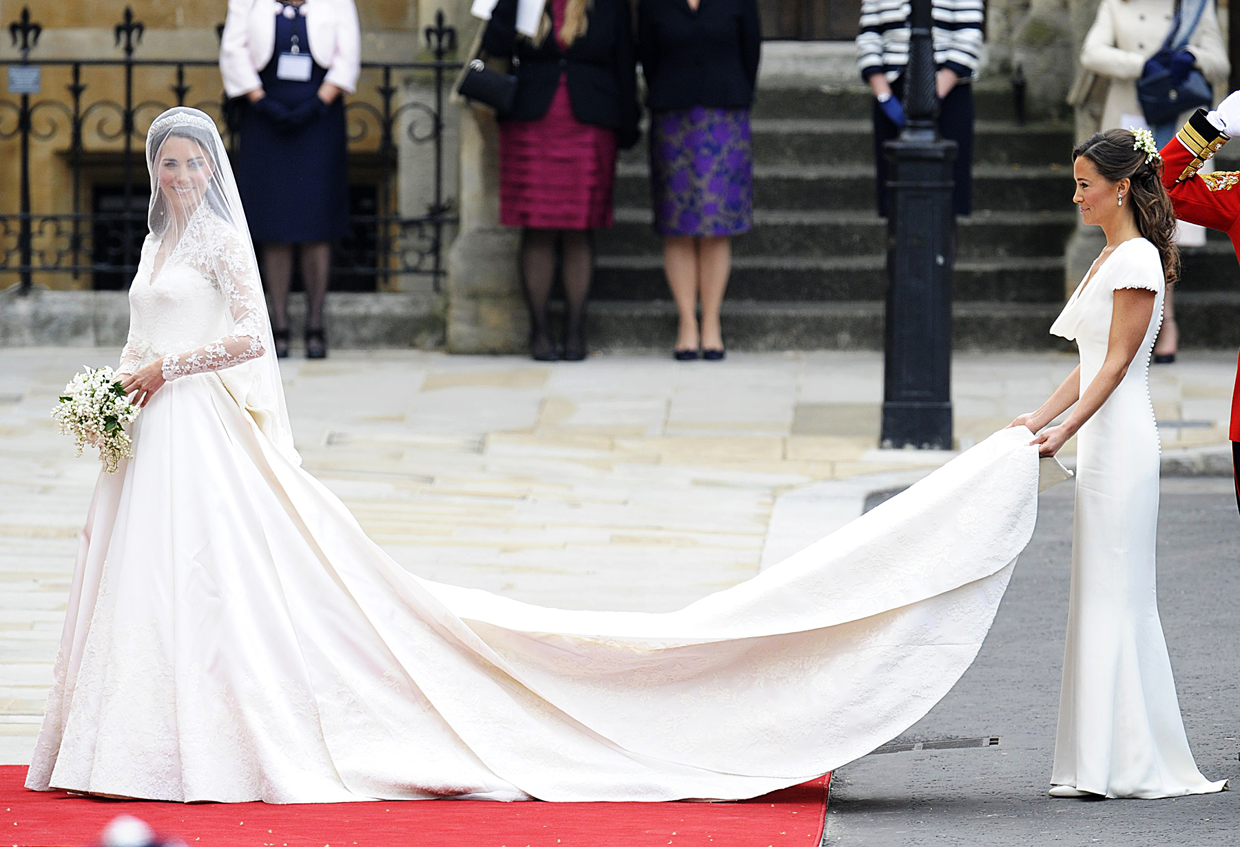 Pippa Middleton carrying Kate Middleton's wedding dress train
