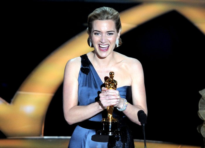 """Winner of the Best Actress award Kate Winslet reacts at the 81st Academy Awards at the Kodak Theater in Hollywood, California on February 22, 2009. Winslet won the prize for her role in """"The Reader""""."""