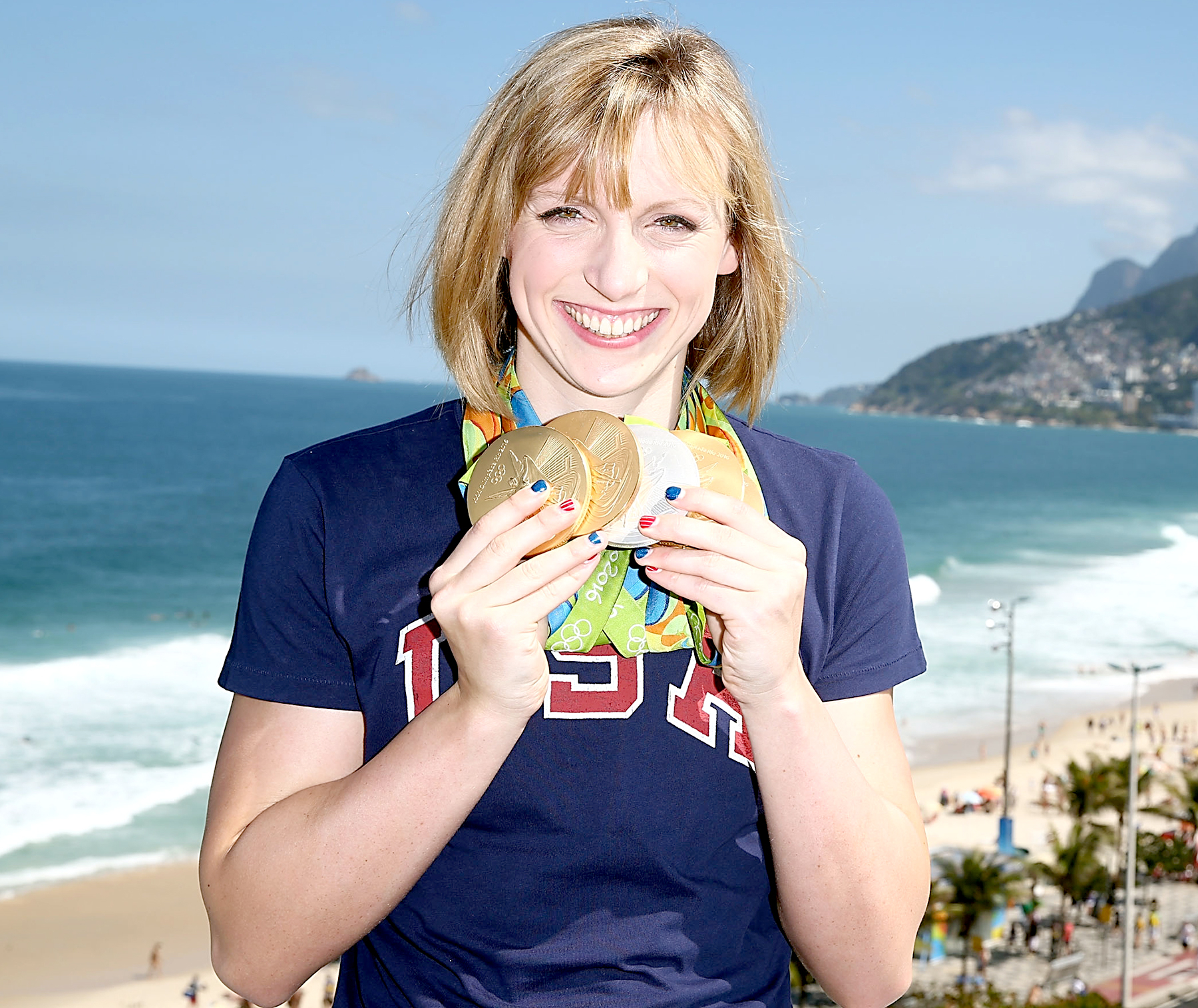 U.S. Olympian Katie Ledecky poses with her Olympic Medals on the Citi Terrace of the USA House at Colegio Sao Paulo on August 13, 2016 in Rio de Janeiro, Brazil.