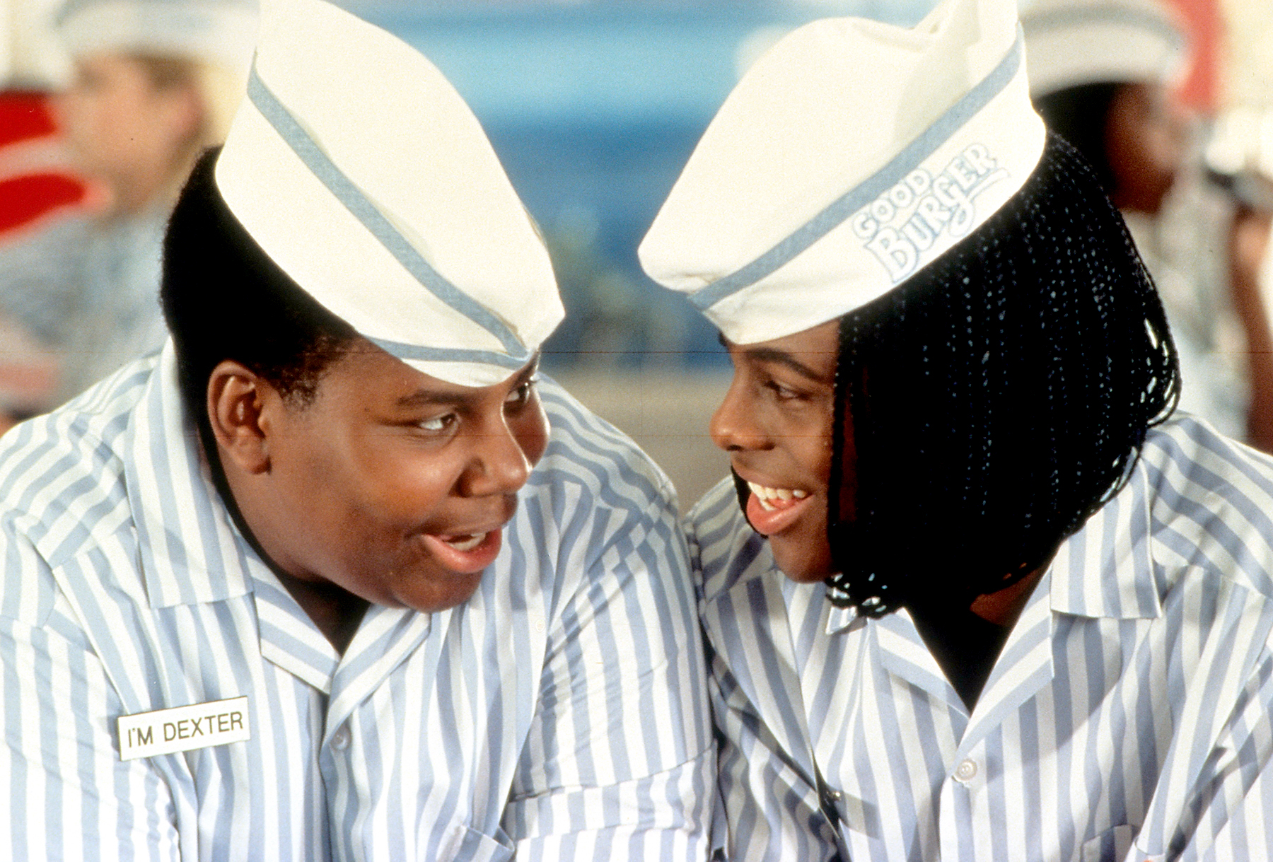Kenan Thompson and Kel Mitchell smiling in a scene from the film 'Good Burger', 1997.