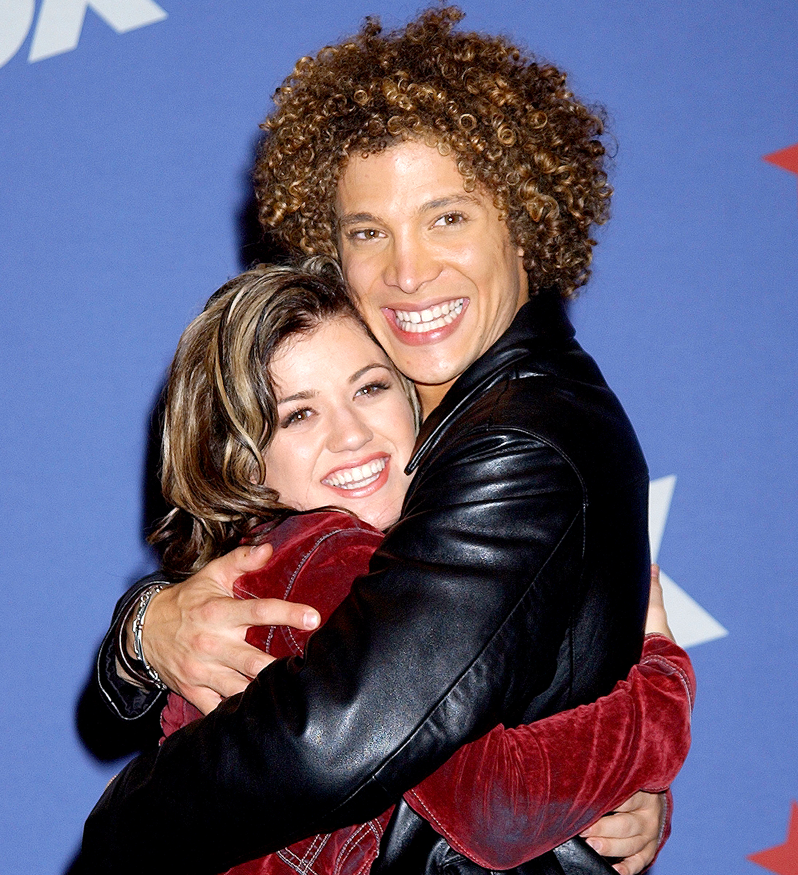 Kelly Clarkson and Justin Guarini during