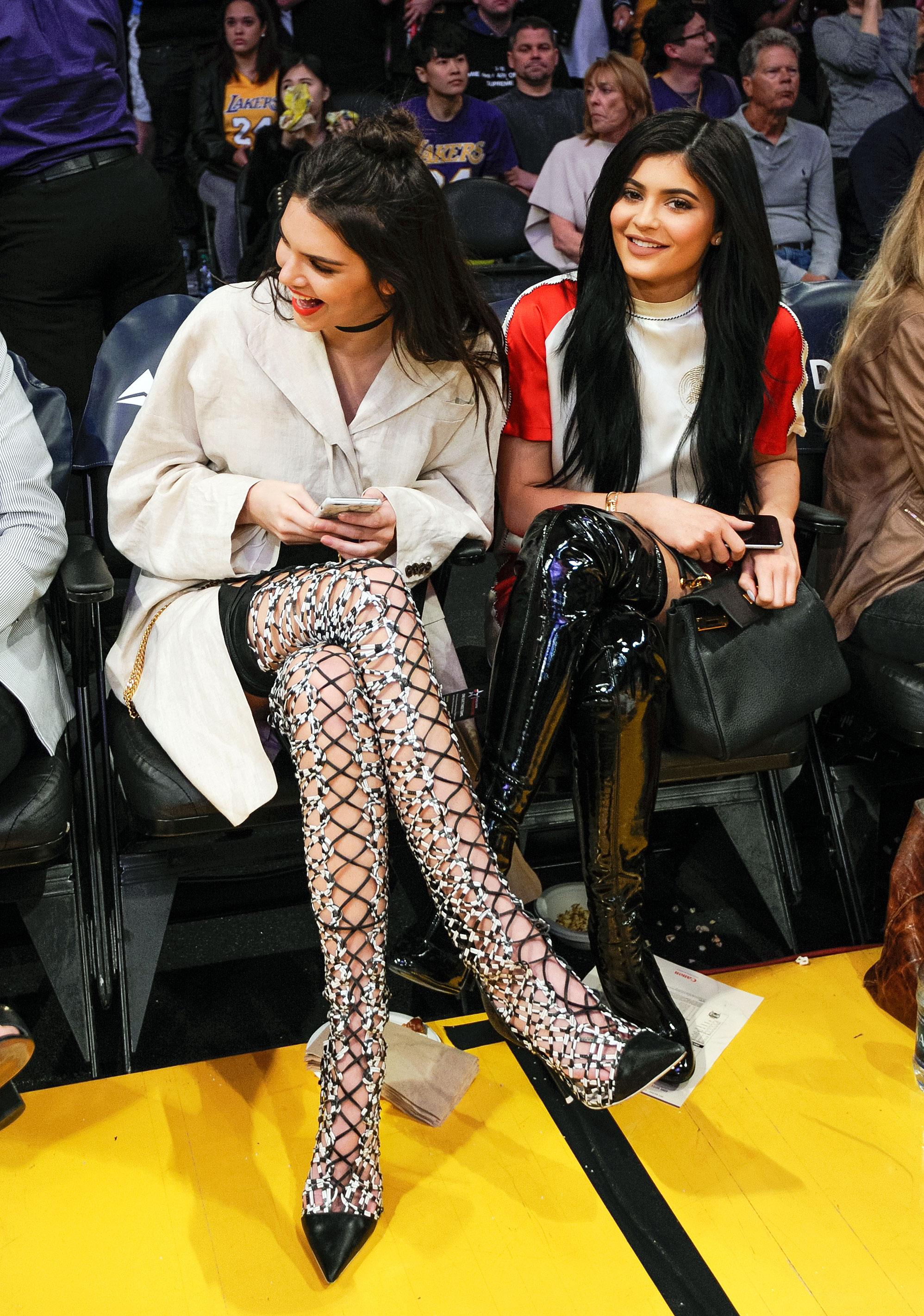 853929600c3c Kendall and Kylie Jenner rocked over-the-knee boots at the Lakers game in  L.A. on March 15. Noel Vasquez Getty