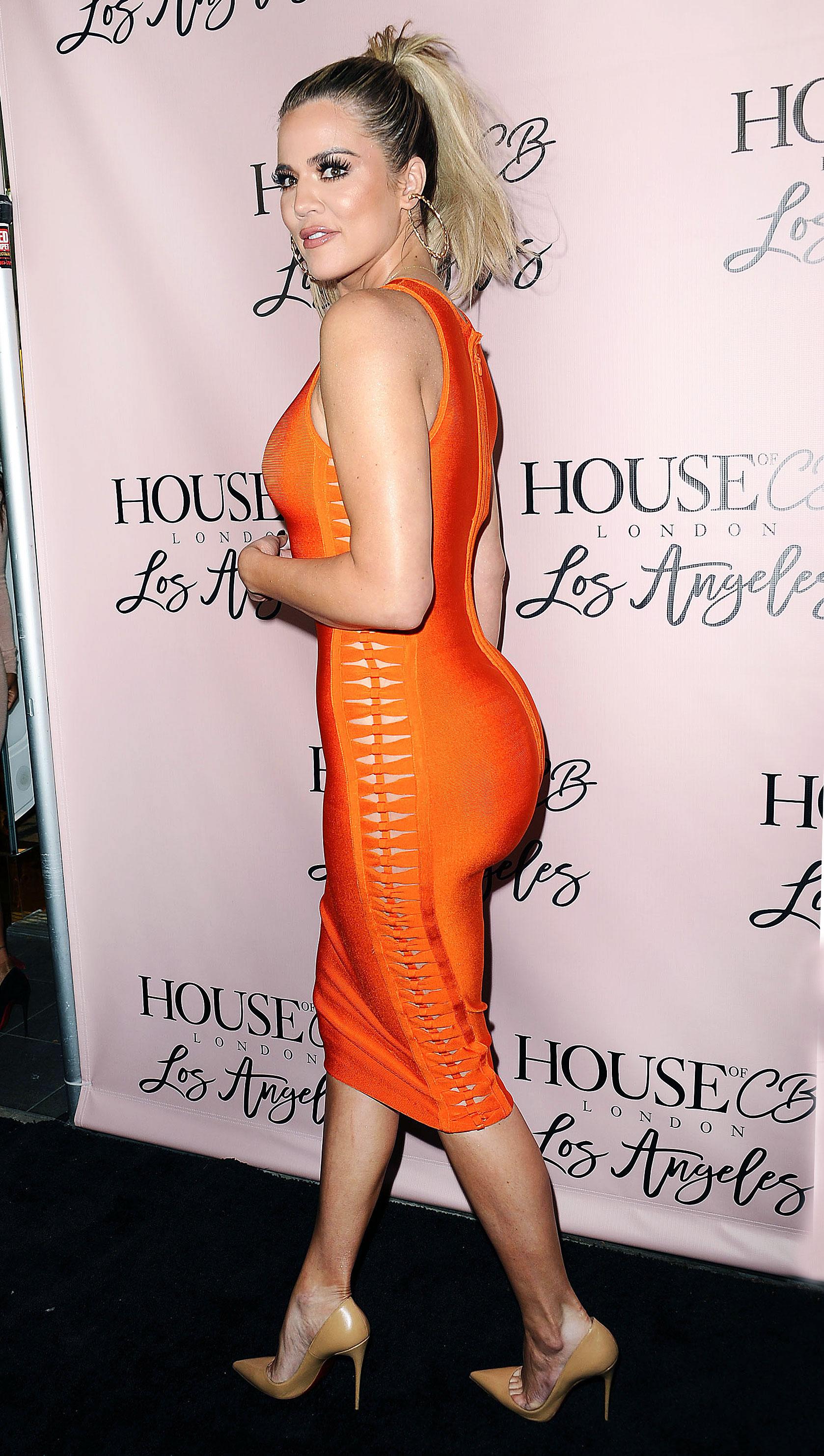 Khloe kardashian wears a tight orange dress red carpet pics for How to dress like khloe kardashian