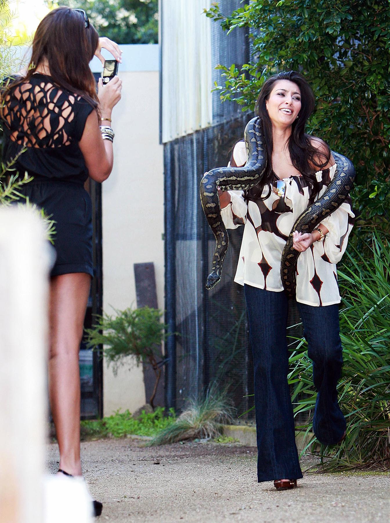 Kim Kardashian and a snake.