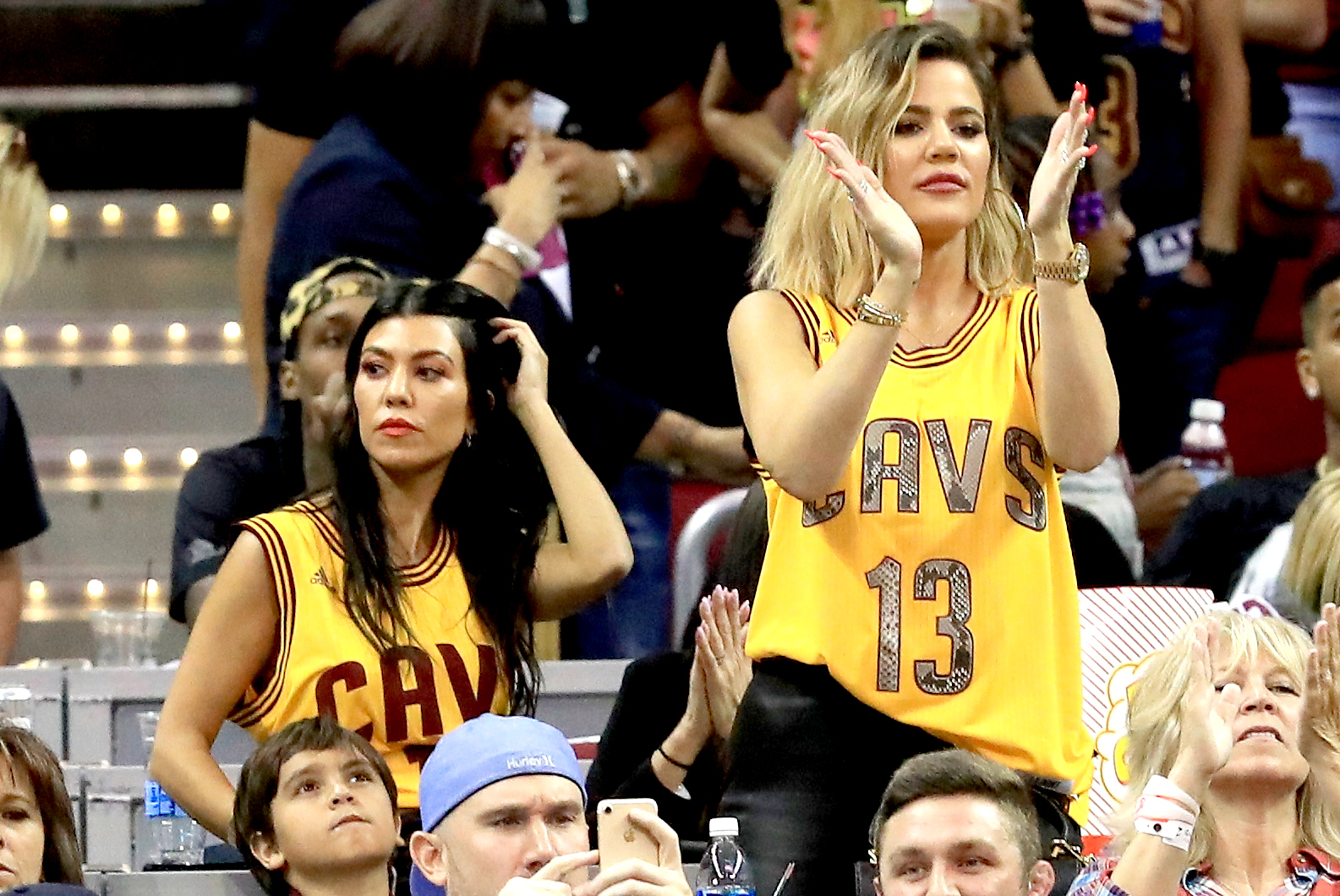 Kourtney Kardashian and Khloe Kardashian attend Game 4 of the 2017 NBA Finals between the Golden State Warriors and the Cleveland Cavaliers at Quicken Loans Arena on June 9, 2017 in Cleveland, Ohio.