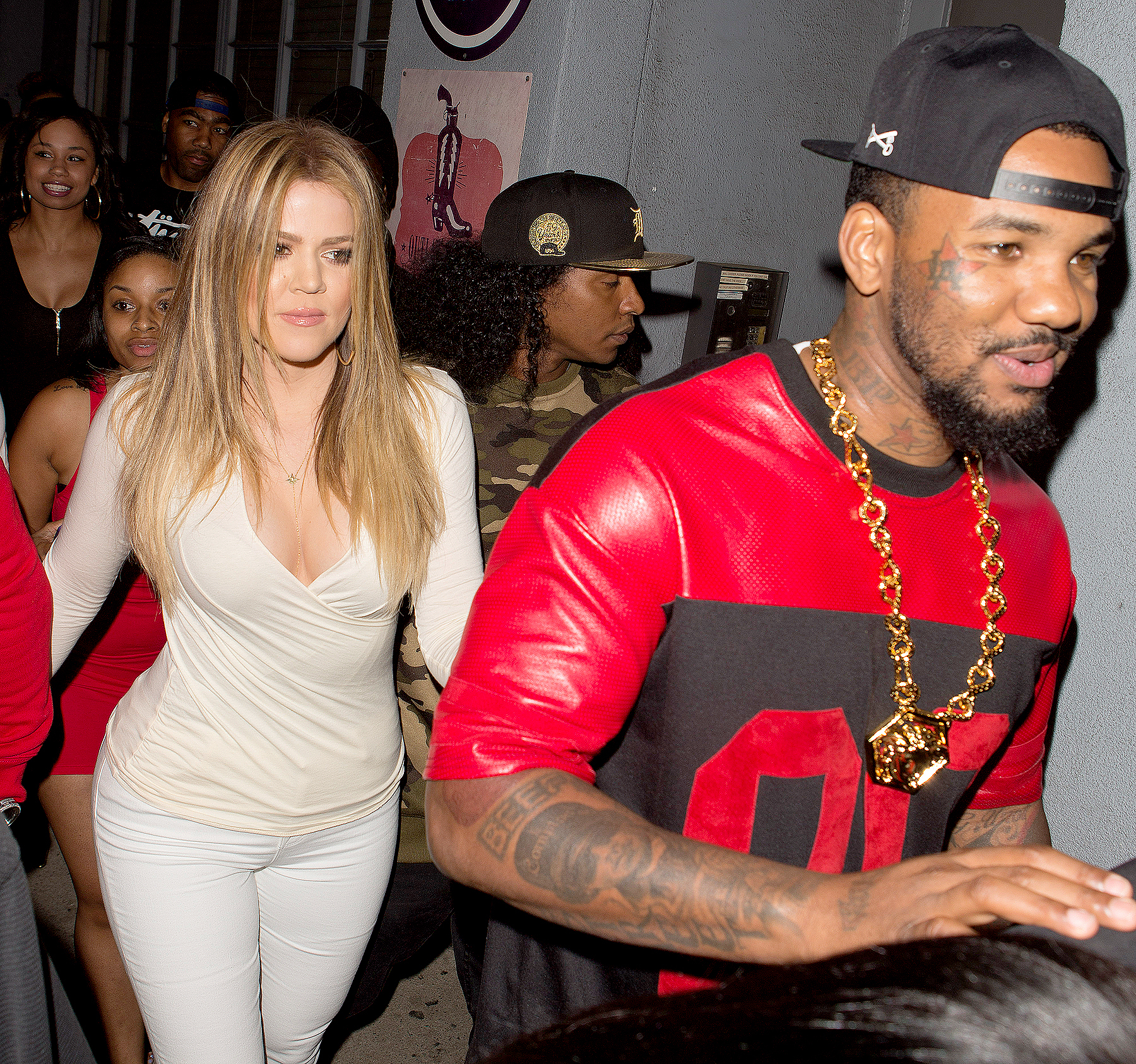 Khloe Kardashian holds hands with rapper The Game as they take Kris Jenner to Tru Night club in Hollywood, CA in 2014.