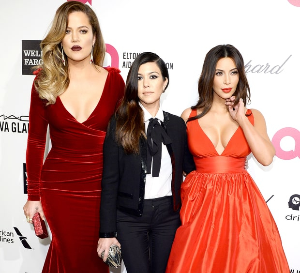 Khloe Kardashian, Kourtney Kardashian and Kim Kardashian arrive for the 22nd Annual Elton John AIDS Foundation's Oscar Viewing Party held at West Hollywood Park on March 2, 2014 in West Hollywood, California.