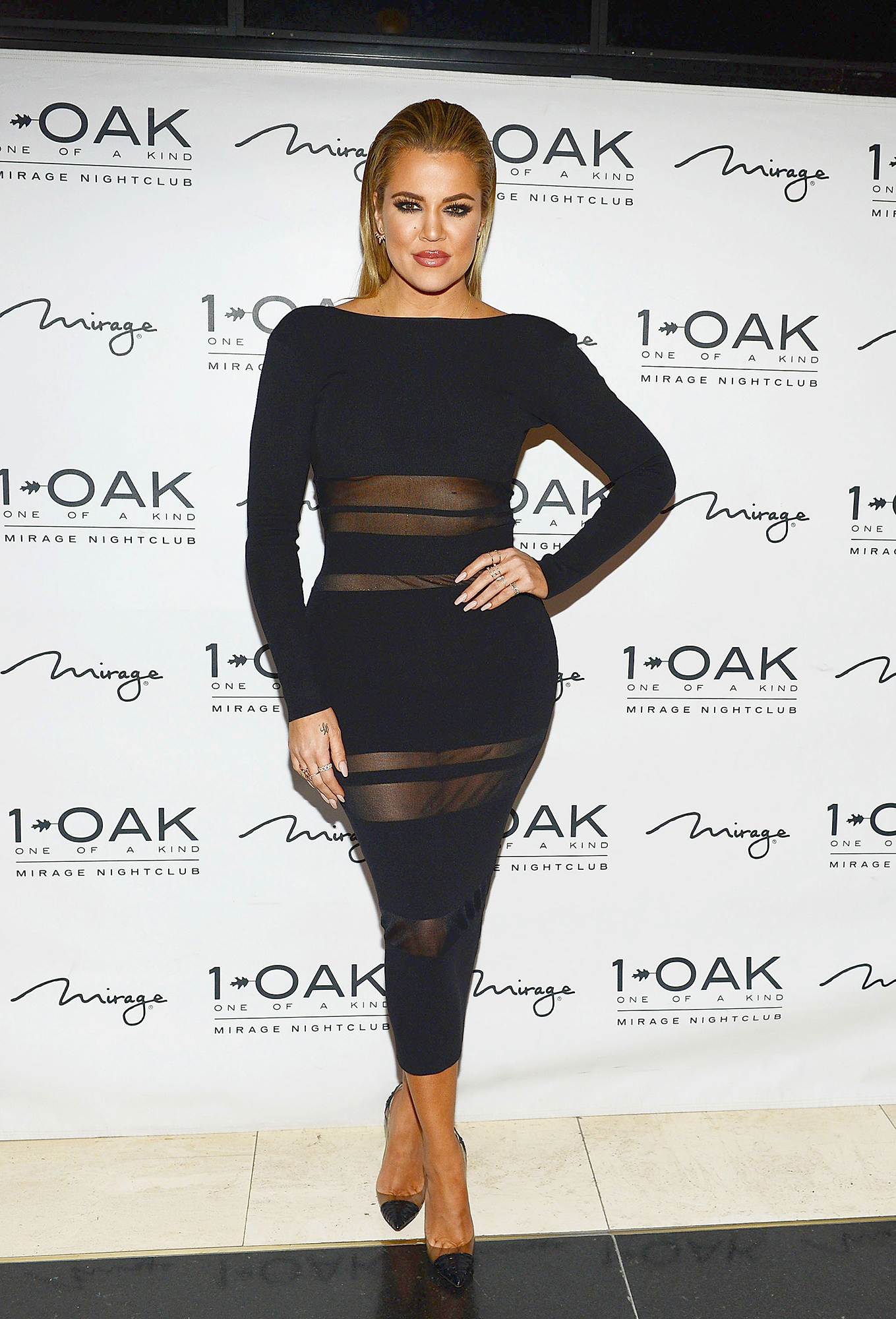 Khloe Kardashian - The Strong Looks Better Naked author flaunted her toned abs in a sexy black minidress with sheer paneling over her midriff during a May 22, 2015, appearance at 1 Oak nightclub in Las Vegas.
