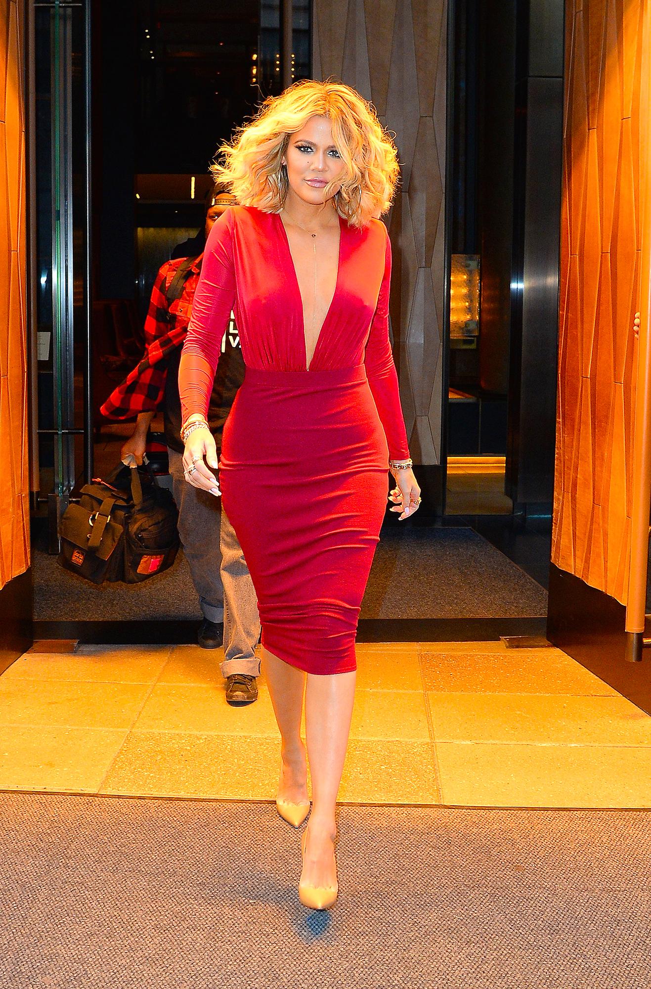 Khloe Kardashian - Khloé sizzled in a plunging, red-hot dress while walking through NYC's SoHo neighborhood on January 15, 2016.