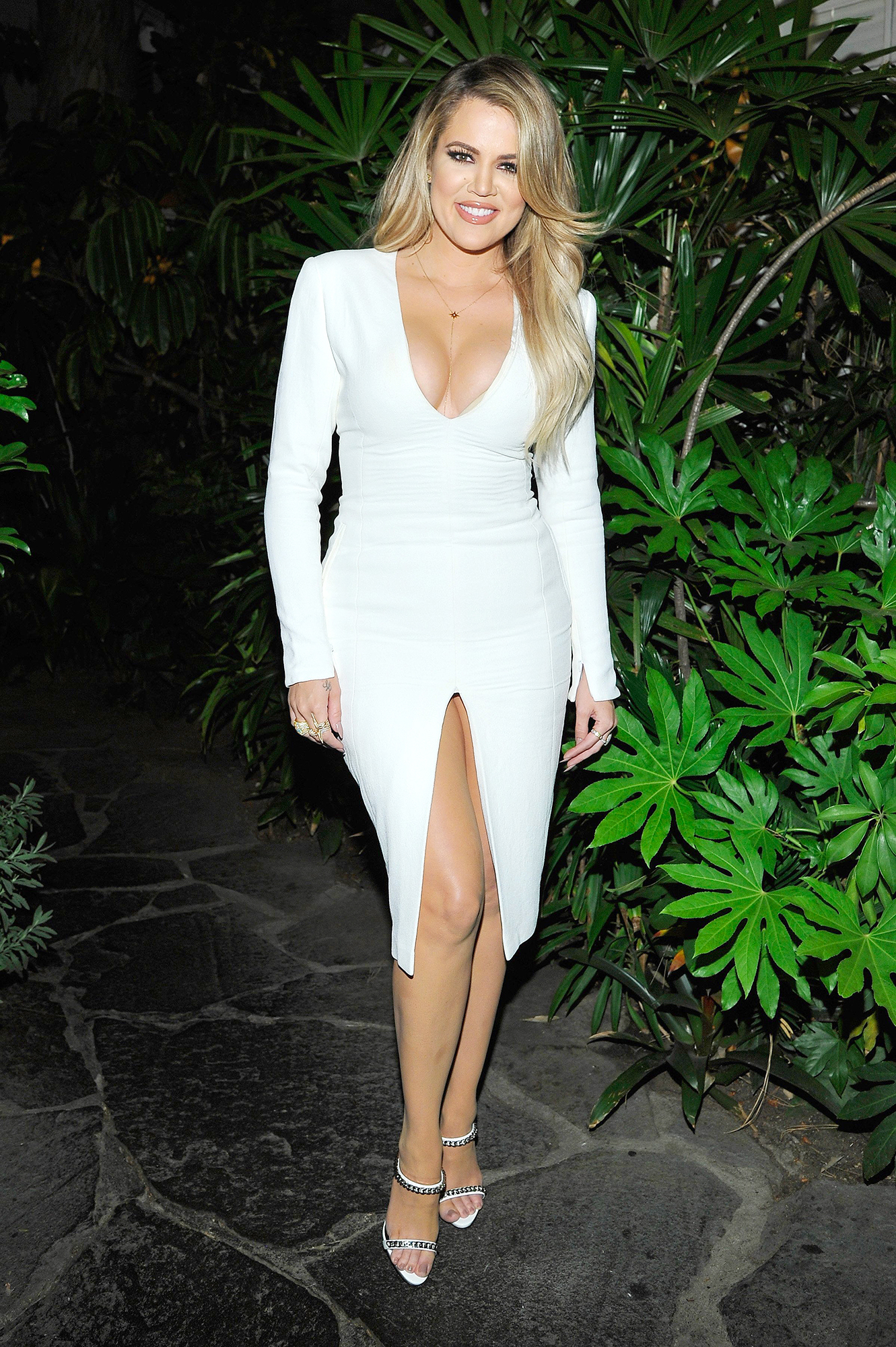 Khloe Kardashian - Khloé showed off her fit physique in a tight white ensemble at the Opening Ceremony and Calvin Klein Jeans' celebration launch of the #mycalvins collection in L.A. on April 23, 2015.