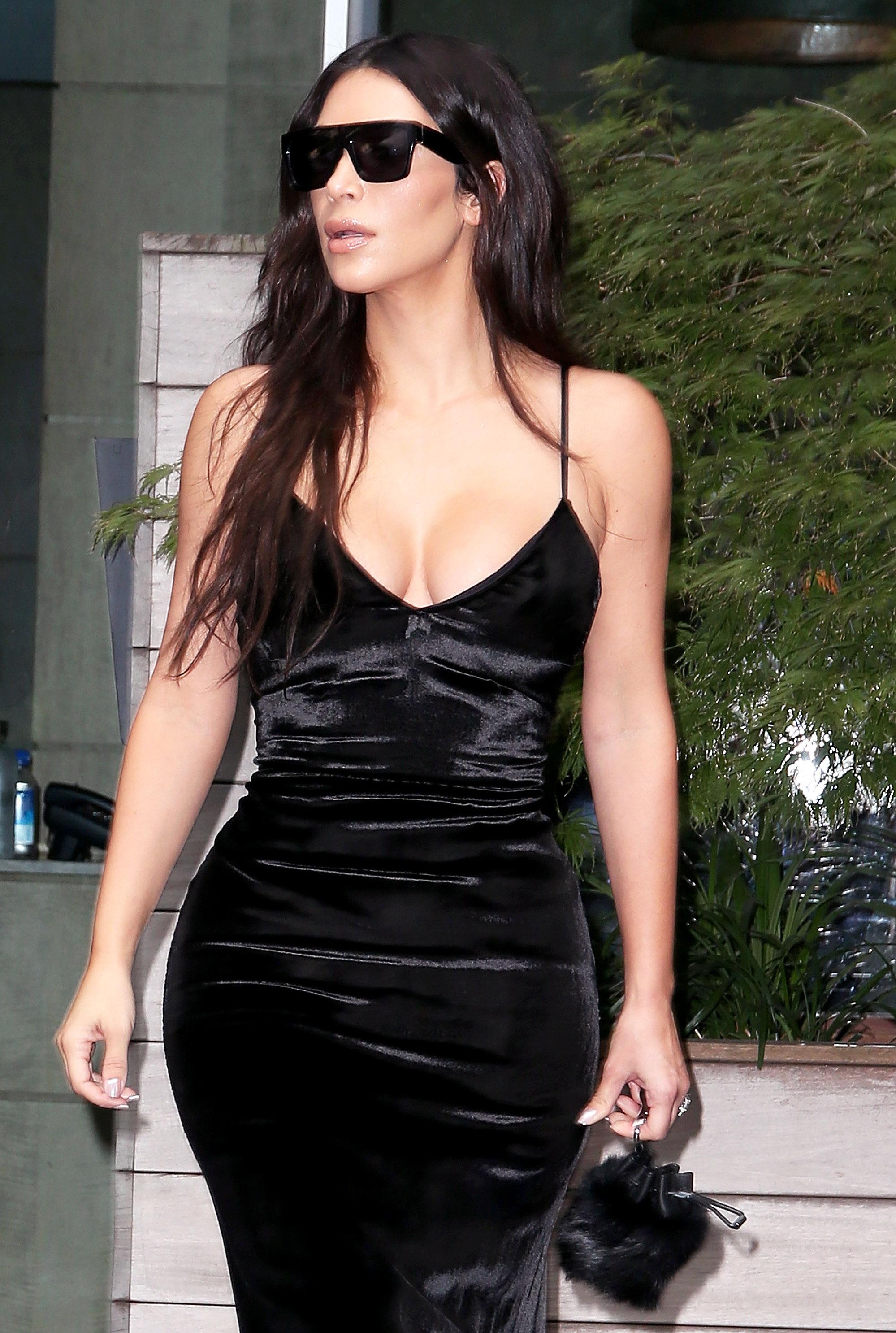 Kim K. Wears Summertime Velvet Dress With Snakeskin Boots: Photos