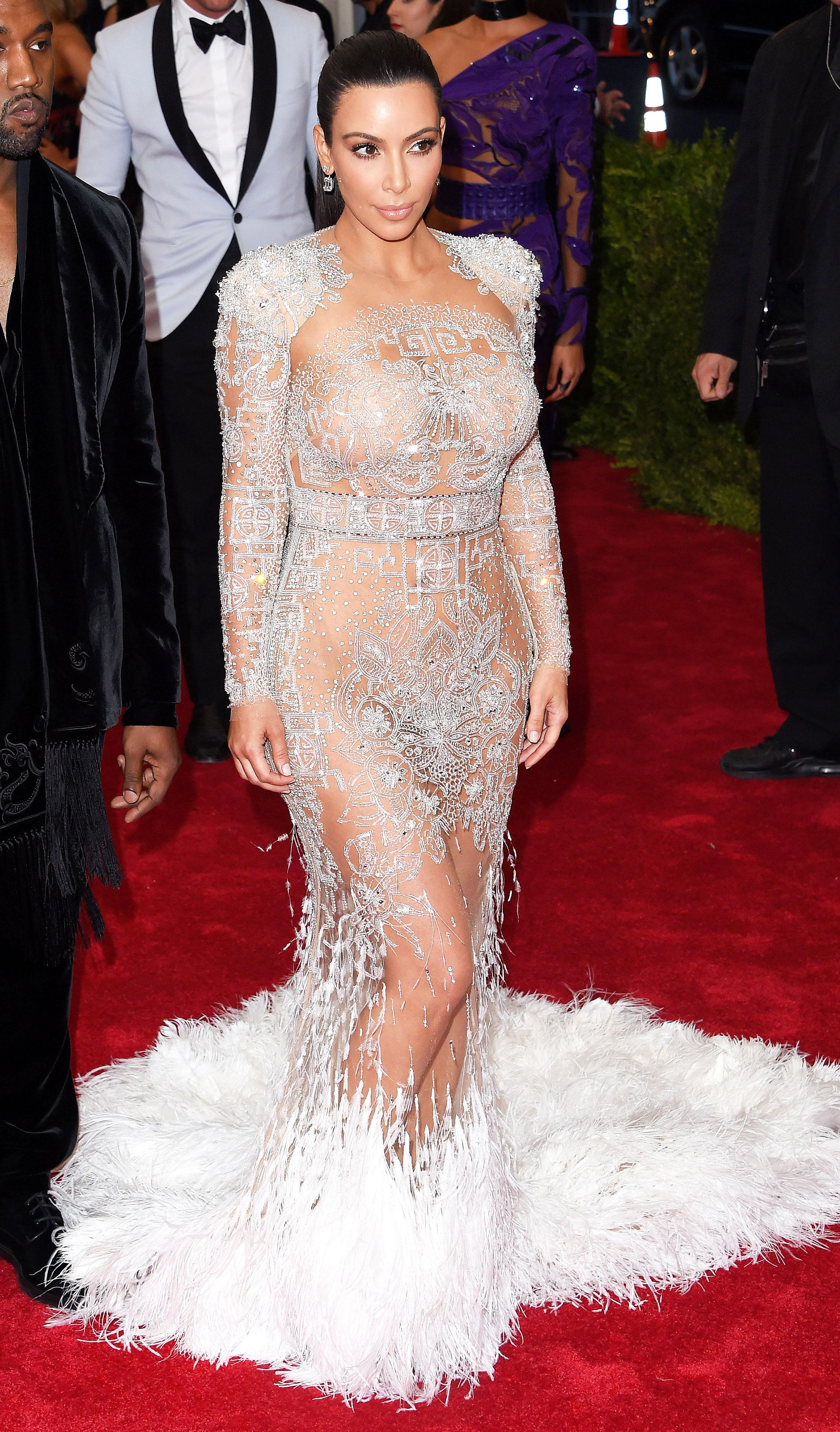 Kim Kardashian dazzles in curve hugging black dress as she ...  |Kim Kardashian Red Carpet Dresses