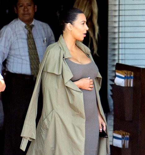 Kim Kardashian (cradles bump)