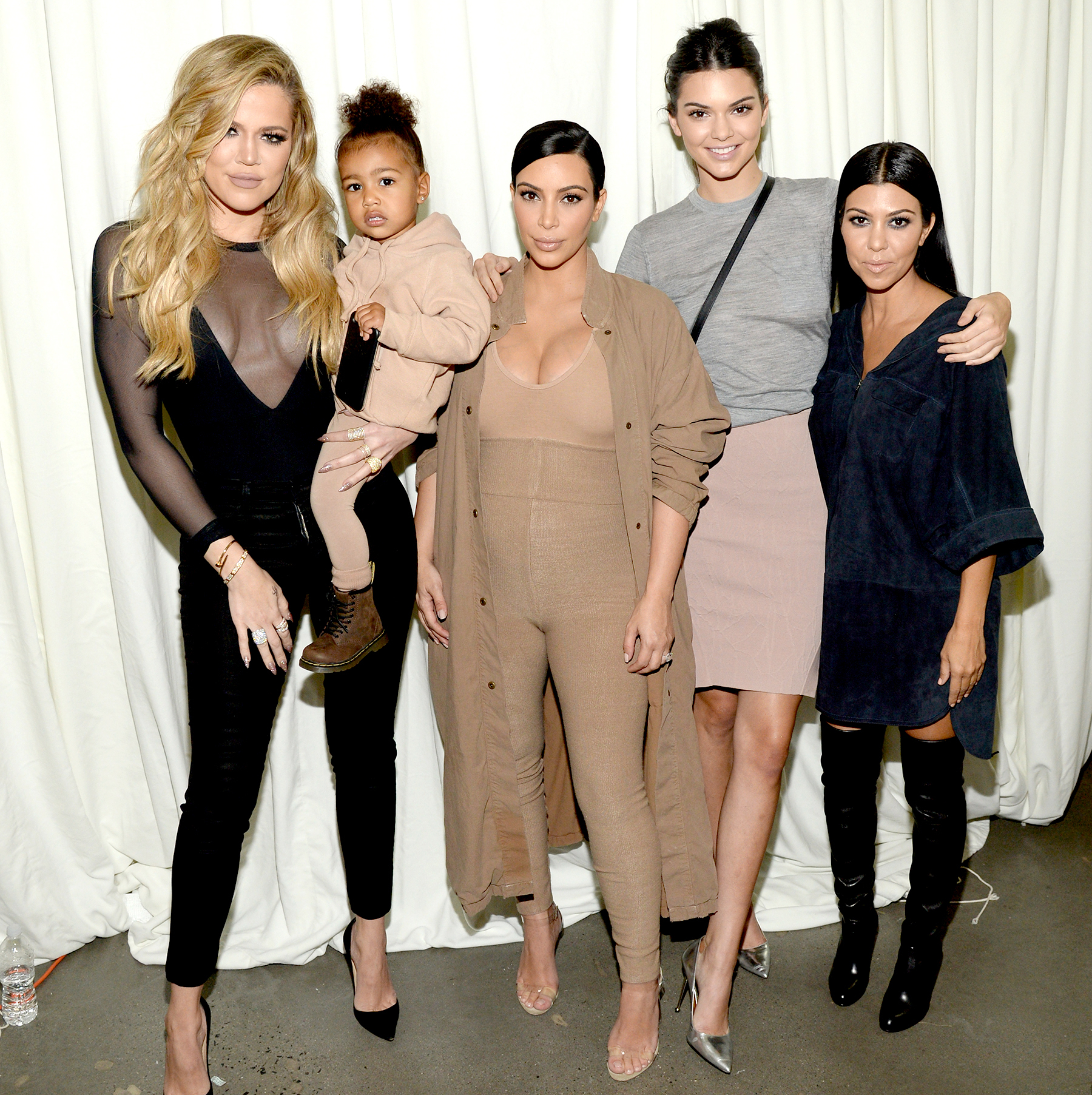 North West and Kim Kardashian West attend Kanye West Yeezy Season 2 during New York Fashion Week at Skylight Modern on September 16, 2015 in New York City.